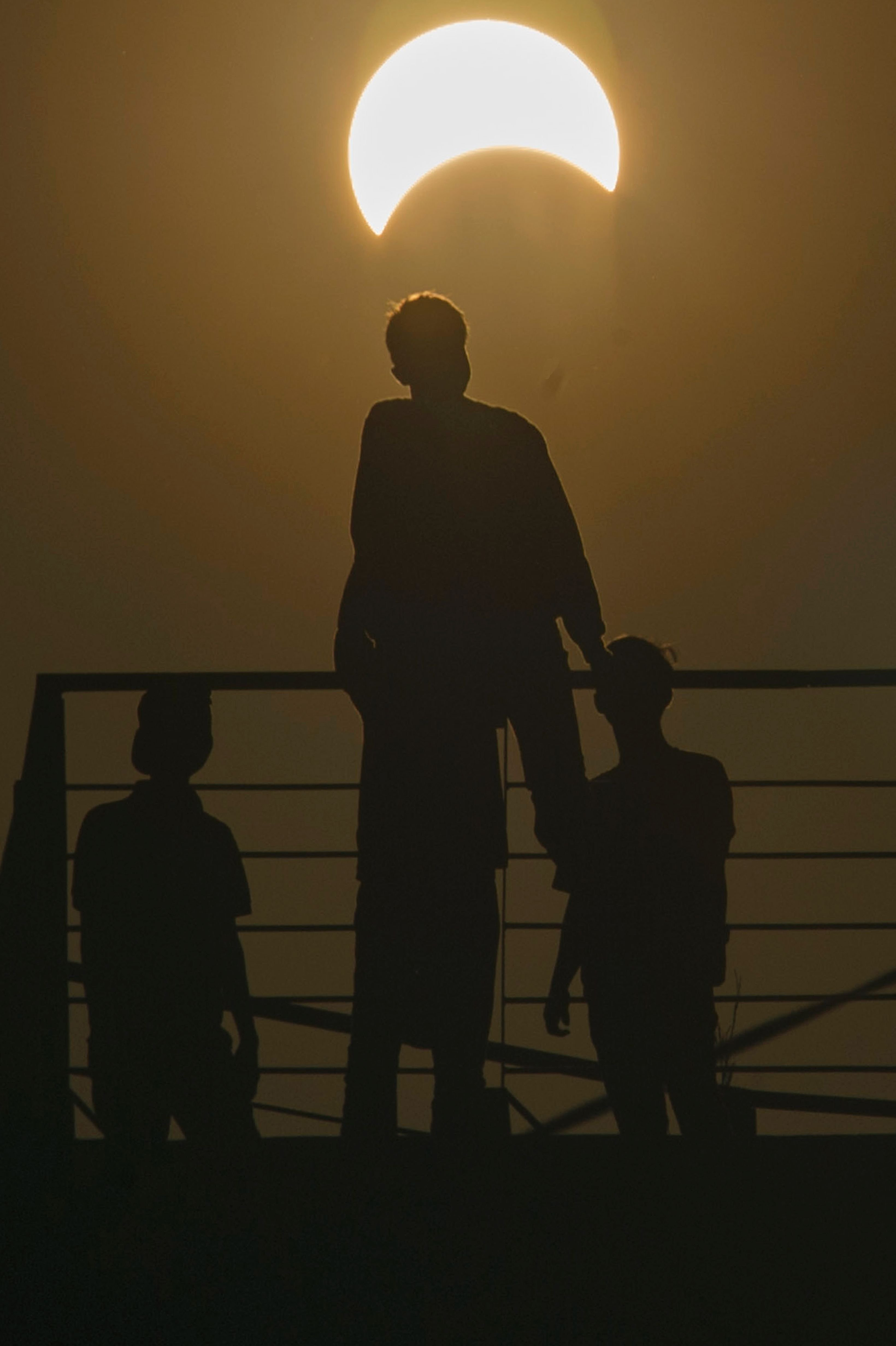 Acehnese men watch the total solar eclipse in Banda Aceh on March 9.