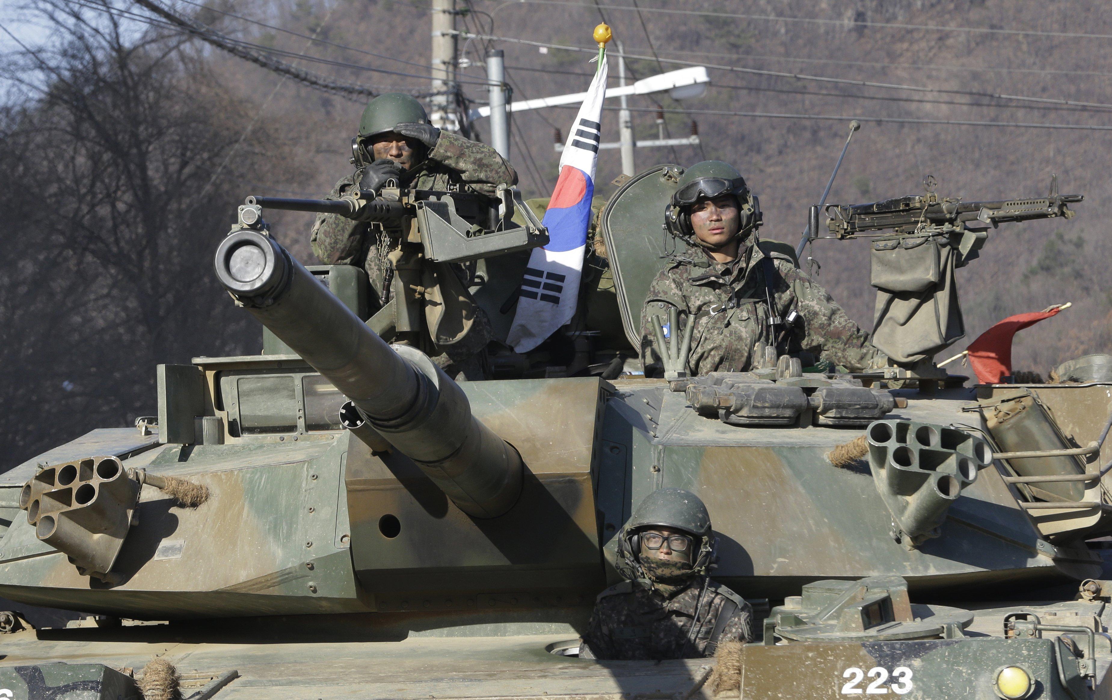 South Korean army soldiers ride a K-1 tank during the annual exercise with their U.S. counterparts in Paju, near the border with North Korea, on March 10, 2016.