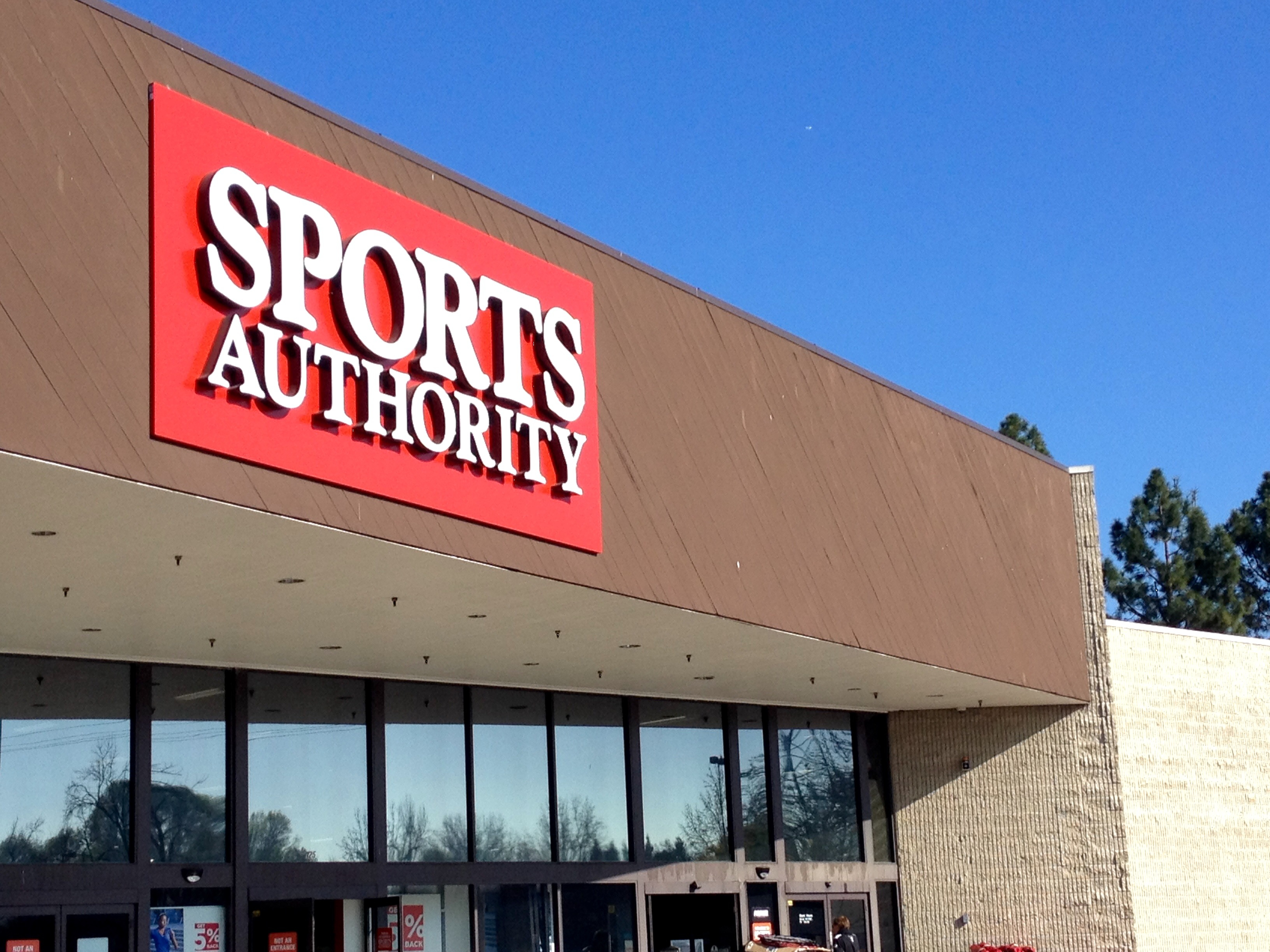 A sign hangs outside of a Sports Authority store in Sunnyvale, California.