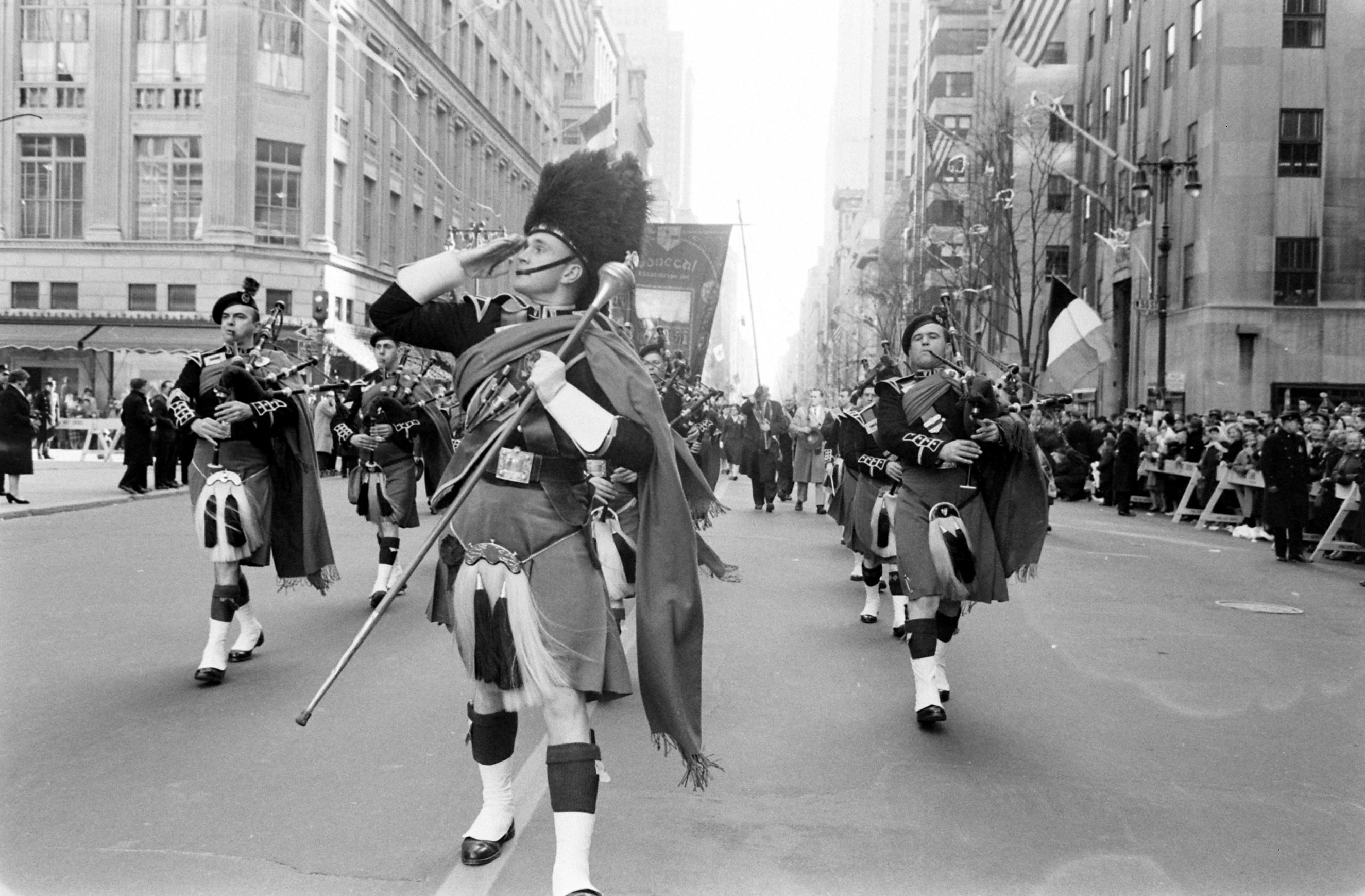 "A band playing bagpipes during the St. Patrick Day Parade. Outtake from ""The Irish in America."" March 17, 1961 issue of LIFE."