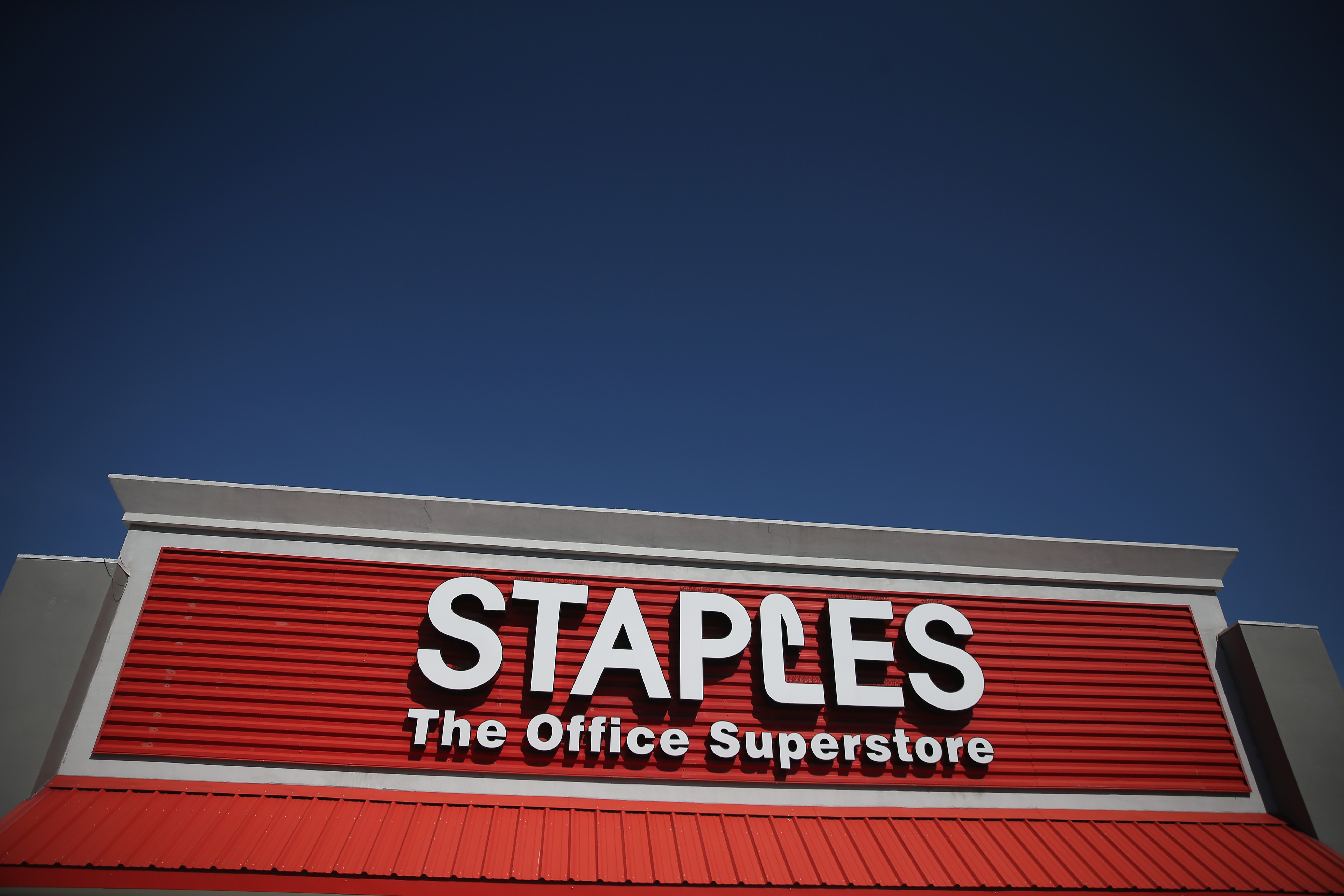The sign logo for a Staples store is seen on February 3, 2015 in Miami, Florida.