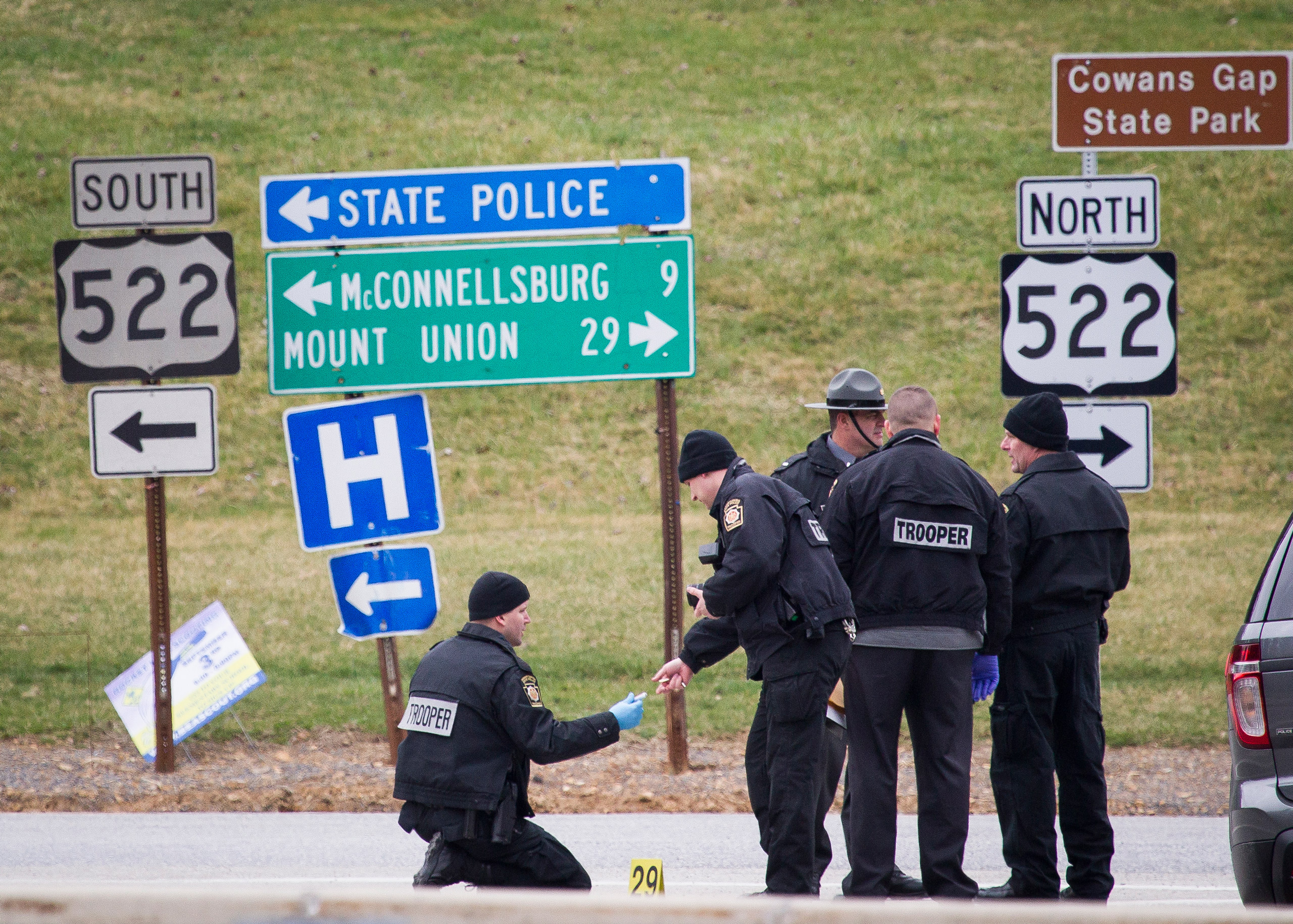Police investigate at exit 180 off of the Pennsylvania Turnpike, in Fort Littleton, Pa, on Mar. 20, 2016.