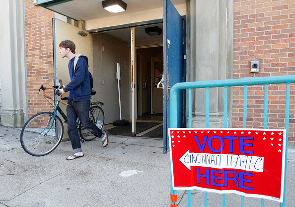 Voters walk out of their precinct after voting as Ohio voters go to the polls for the Ohio primary March 15, 2016, at St George Church in Cincinnati, Ohio.