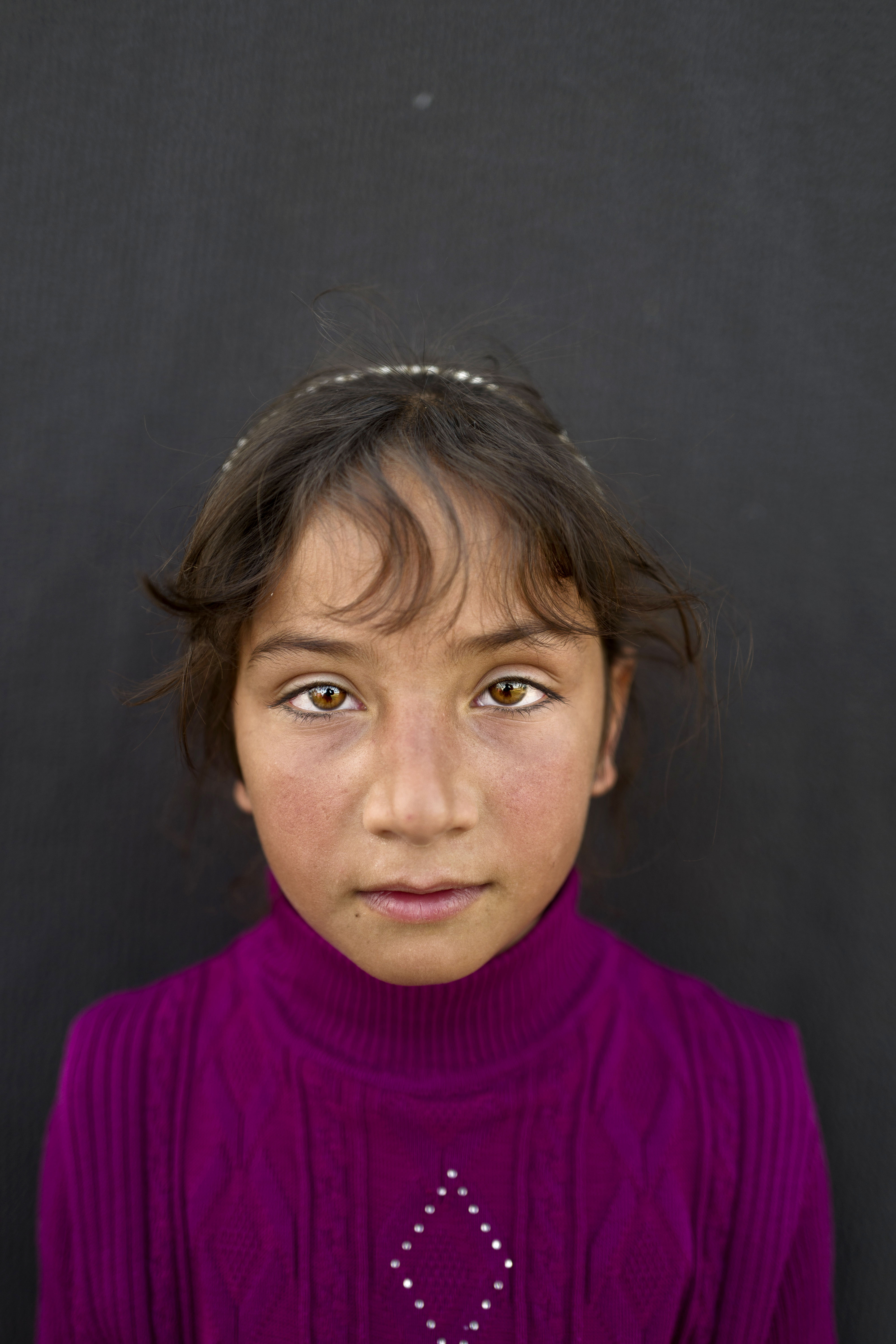"""<strong>Mariam Aloush</strong>, 8, from Homs. """"I remember our home in Syria and my school there. I just want to go back,"""" says Aloush."""