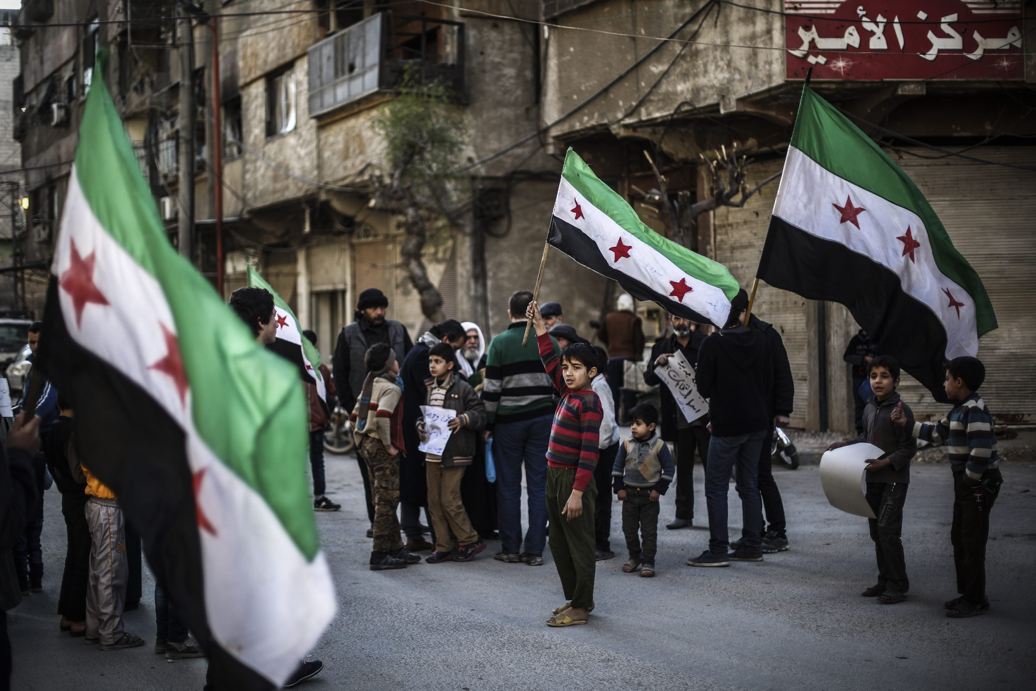 Syrians during a protest against the airstrikes which broke the Russian-US brokered ceasefire, in Douma, Syria, on March 11, 2016.