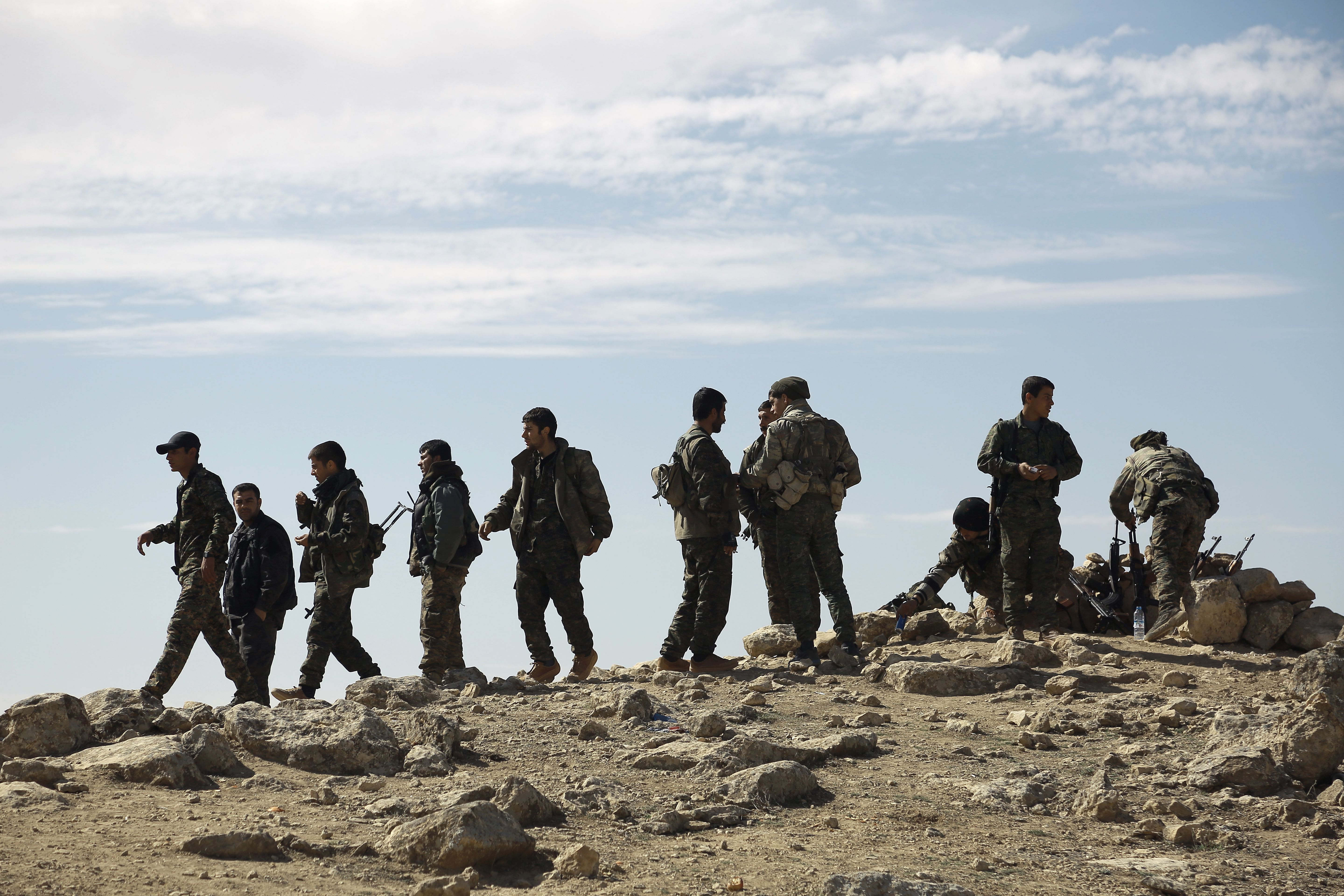 Fighters from the Syrian Democratic Forces gather on the outskirts of the town of al-Shadadi in the northeastern Syrian province of Hasakeh, on Feb. 19, 2016.