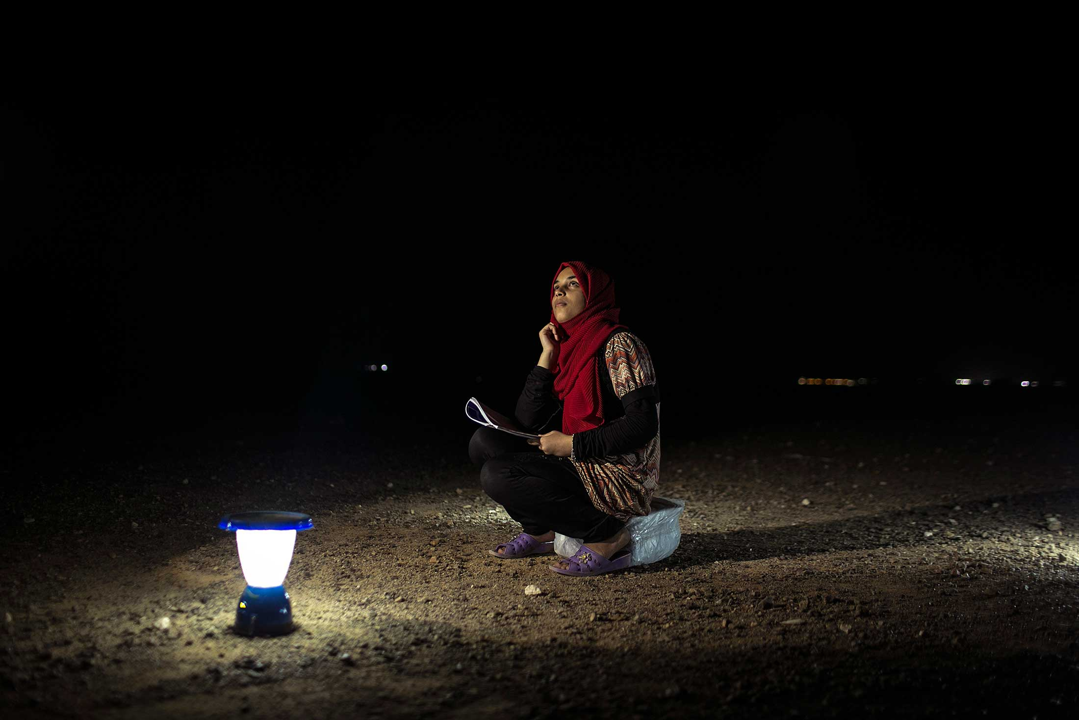 Fifteen-year-old Budoor (which means full moon in Arabic) sketches the night sky in Azraq refugee camp.