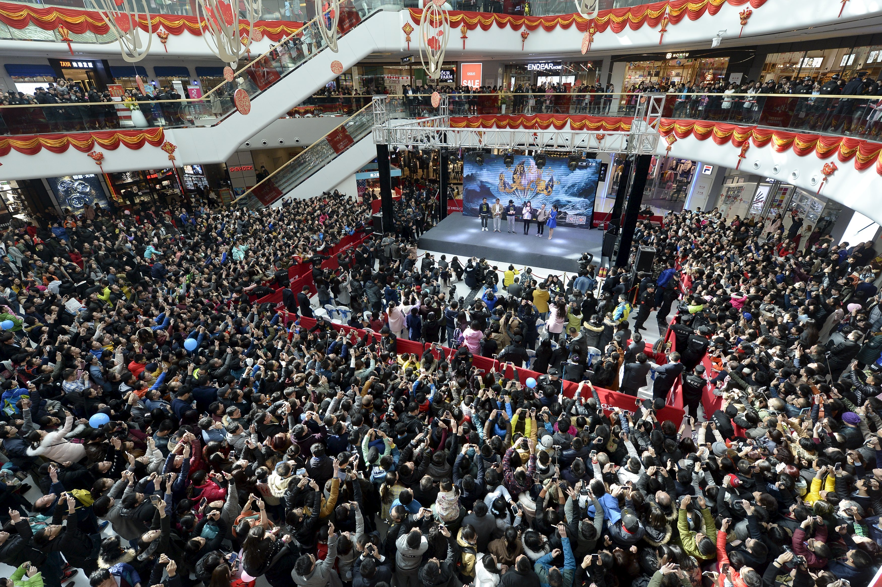 People attend a promotional event with Hong Kong star Stephen Chow for the film, The Mermaid, in Taiyuan, China, on Feb. 17, 2016.