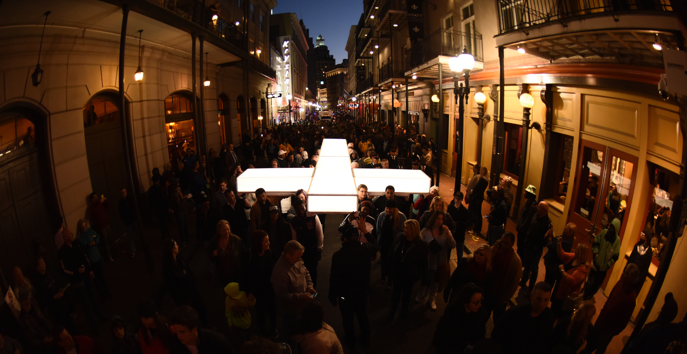 The cross being carried through the streets of New Orleans in  The Passion , a two-hour epic musical Live event from New Orleans on Palm Sunday, March 20, 2016.