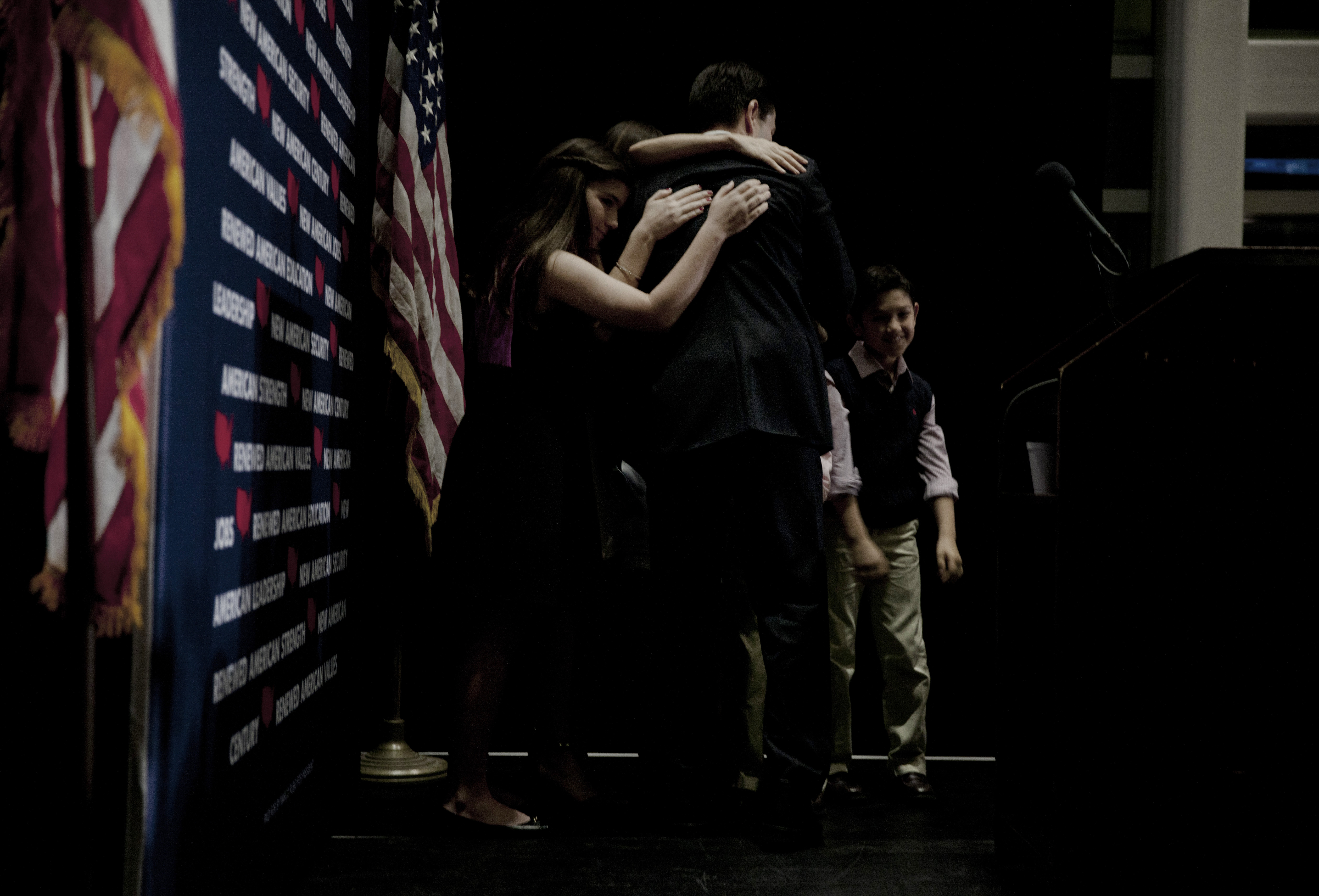 Republican presidential candidate, Florida Sen. Marco Rubio hugs his family as he suspends his presidential campaign on March 15 in Miami.
