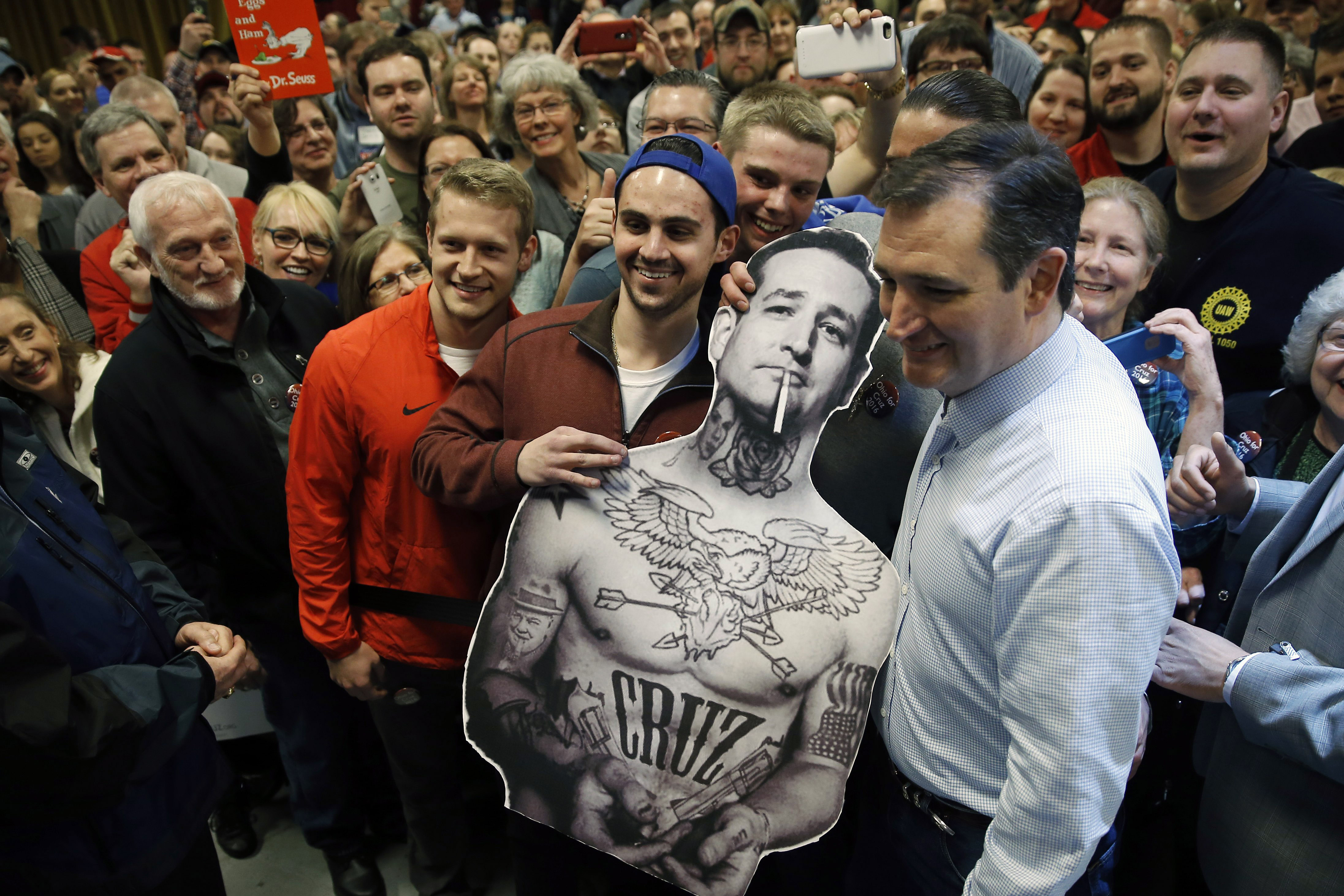 Republican presidential candidate, Texas Sen. Ted Cruz poses for photographs with a cut-out during a campaign stop on March 13 in Columbus, Ohio.