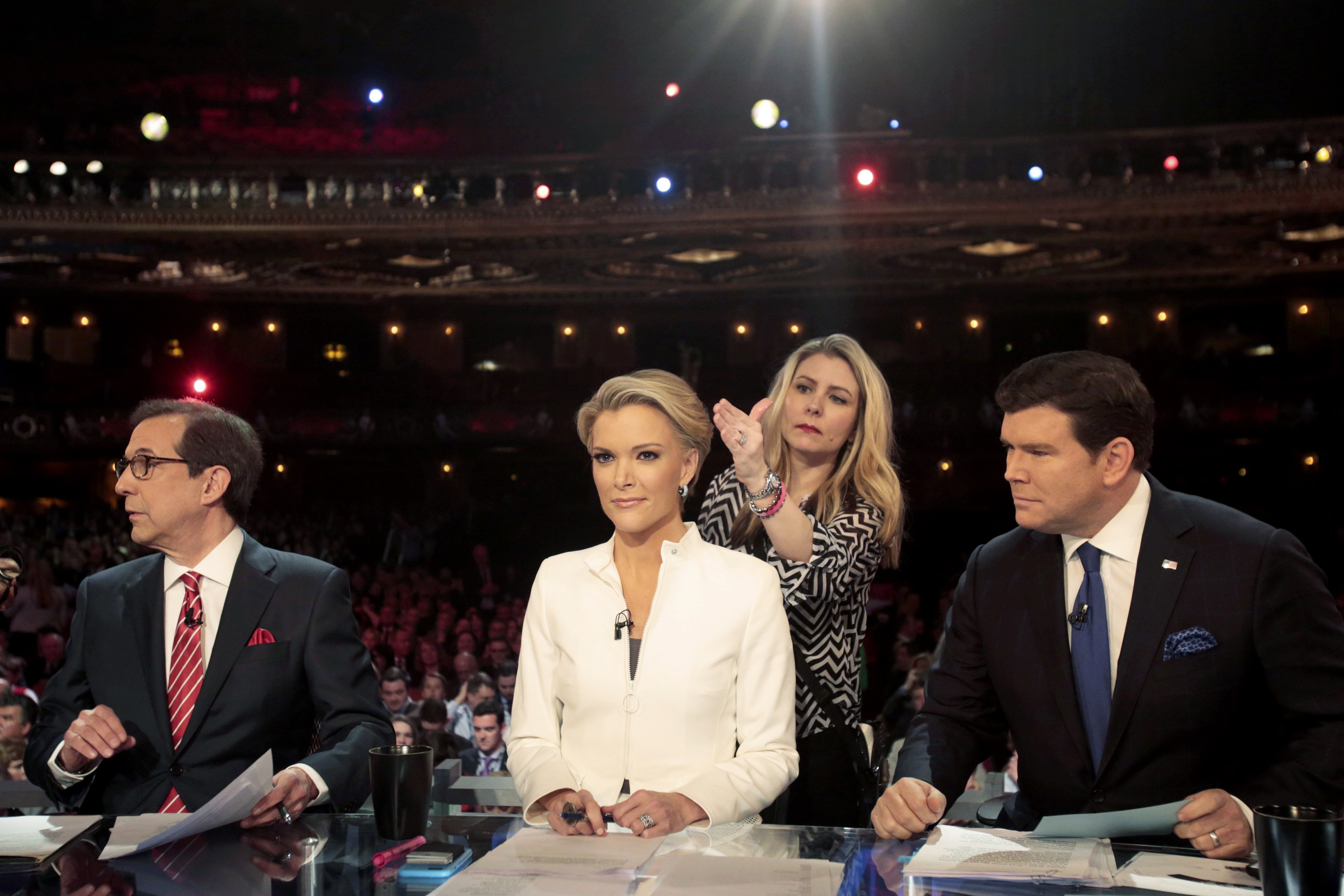 Fox News Channel anchors, from left, Chris Wallace, Megyn Kelly and Bret Baier moderate a debate in Detroit, on March 3.
