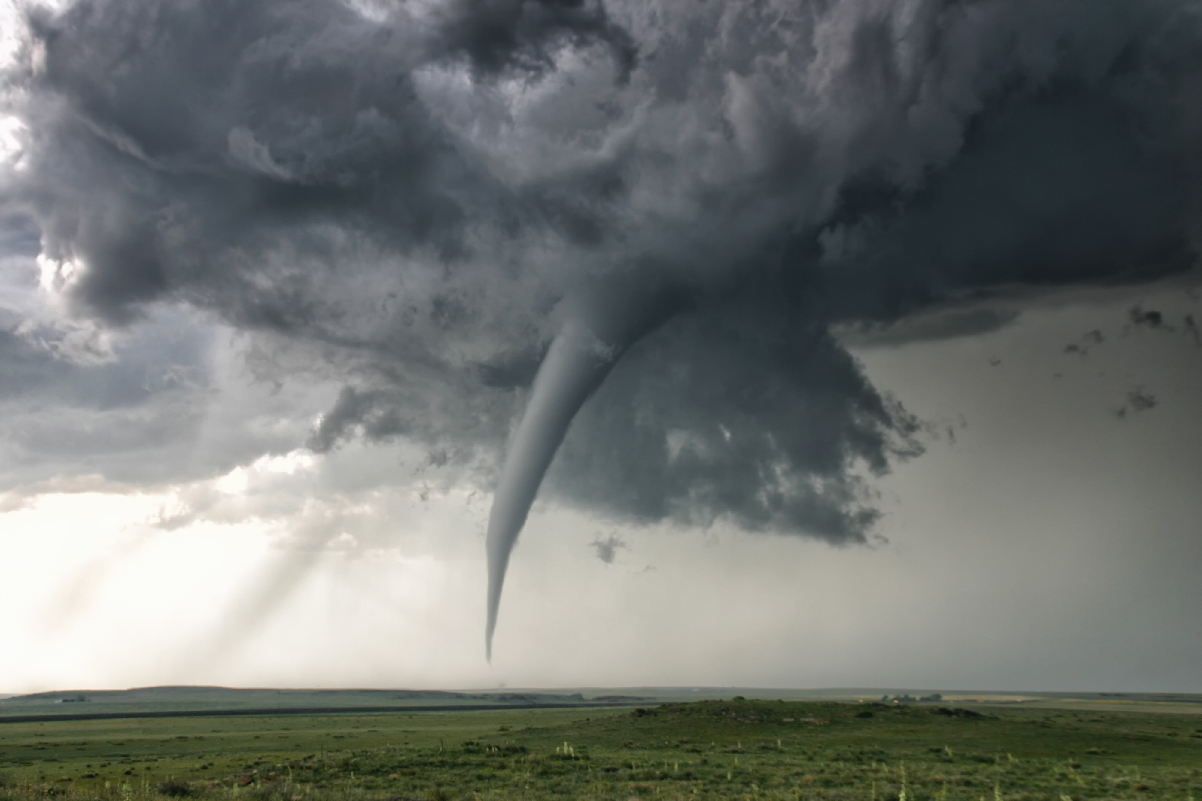 A perfectly needle-like cone tornado reaches out for the ground, Campo, Colorado, USA