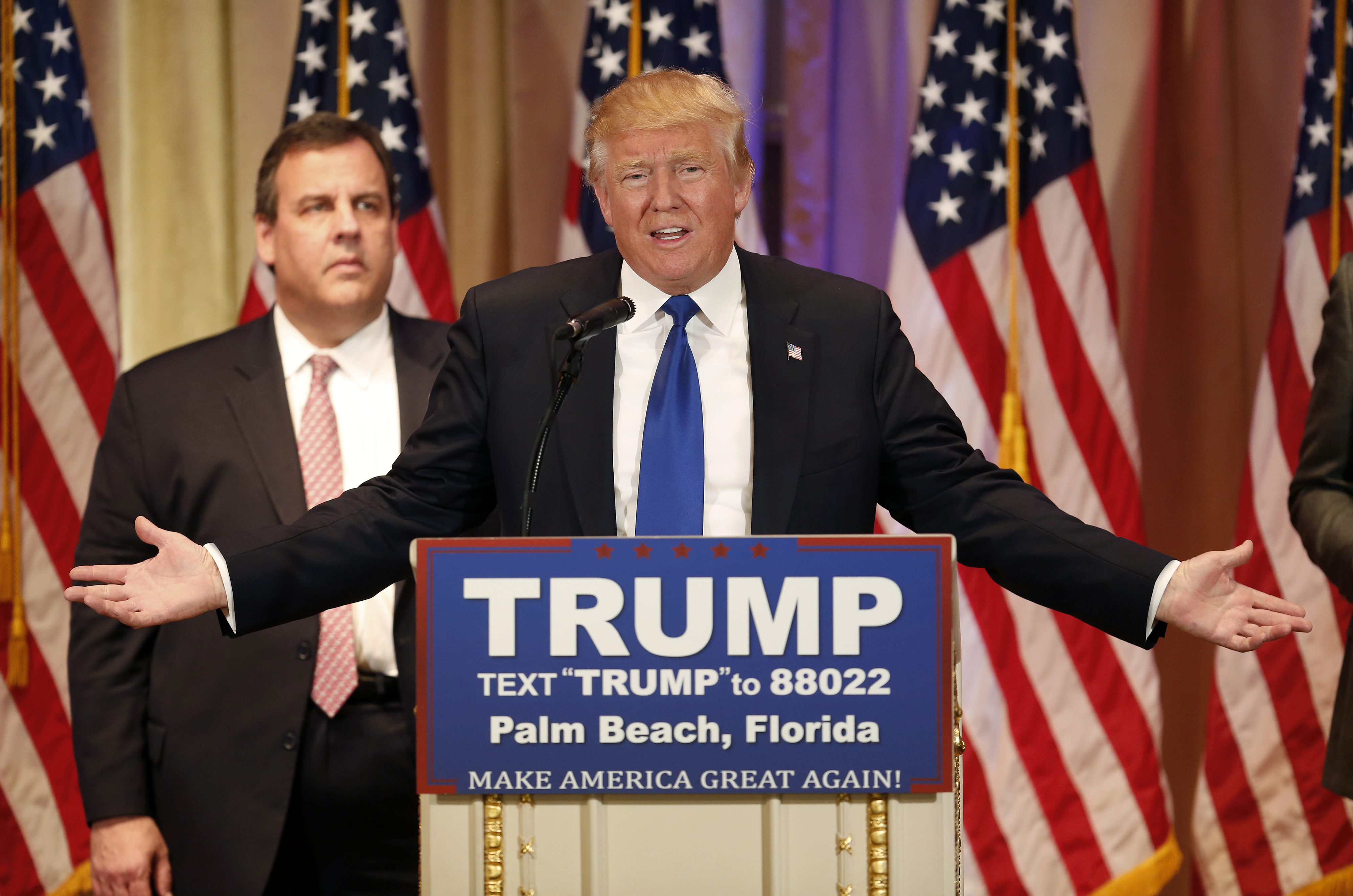 Donald Trump speaks on stage with Chris Christie in Palm Beach, Florida, on March 1, 2016.