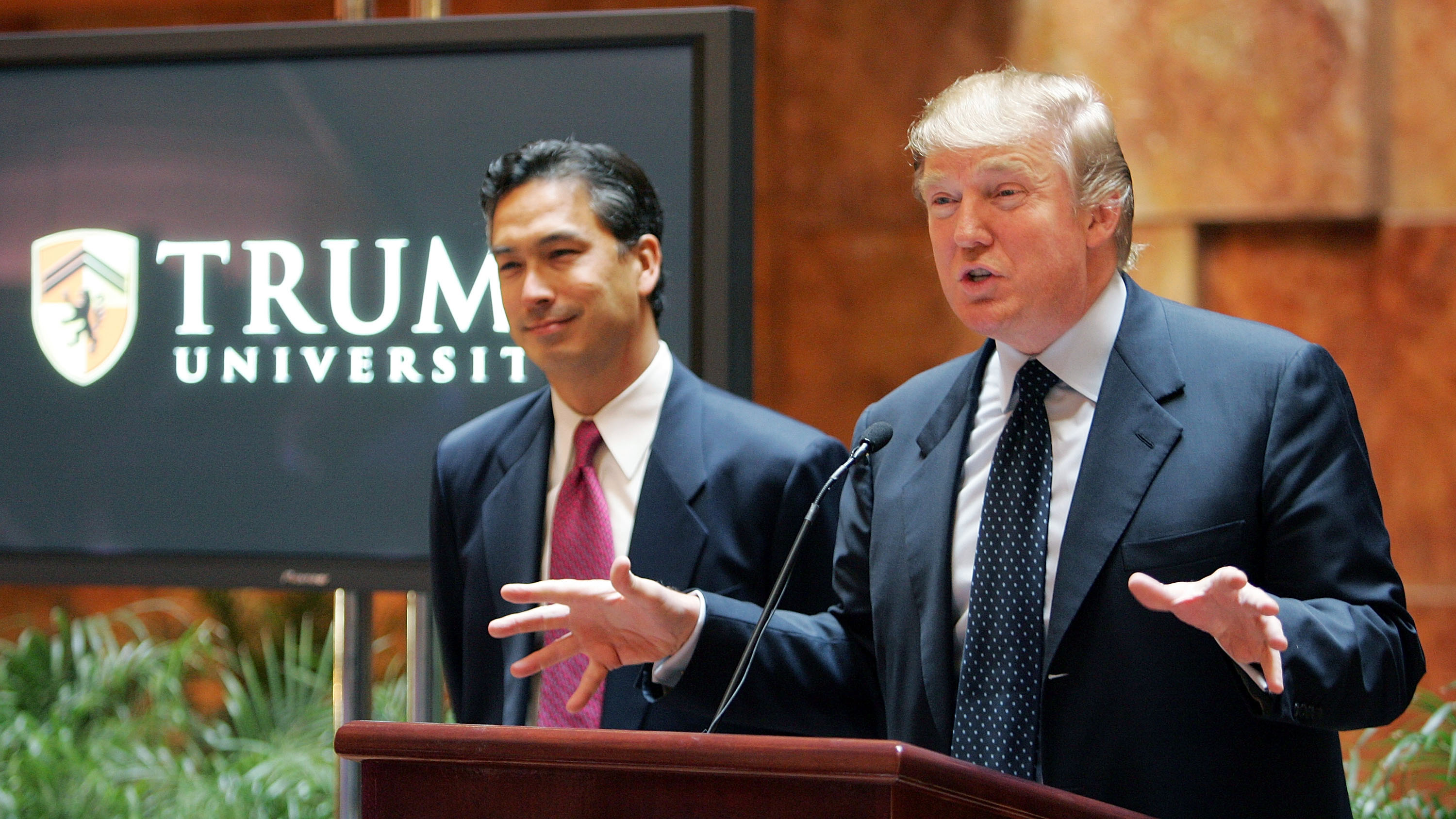 Donald Trump (R) speaks as university president Michael Sexton (L) looks on during a news conference announcing the establishment of Trump University May 23, 2005 in New York City.