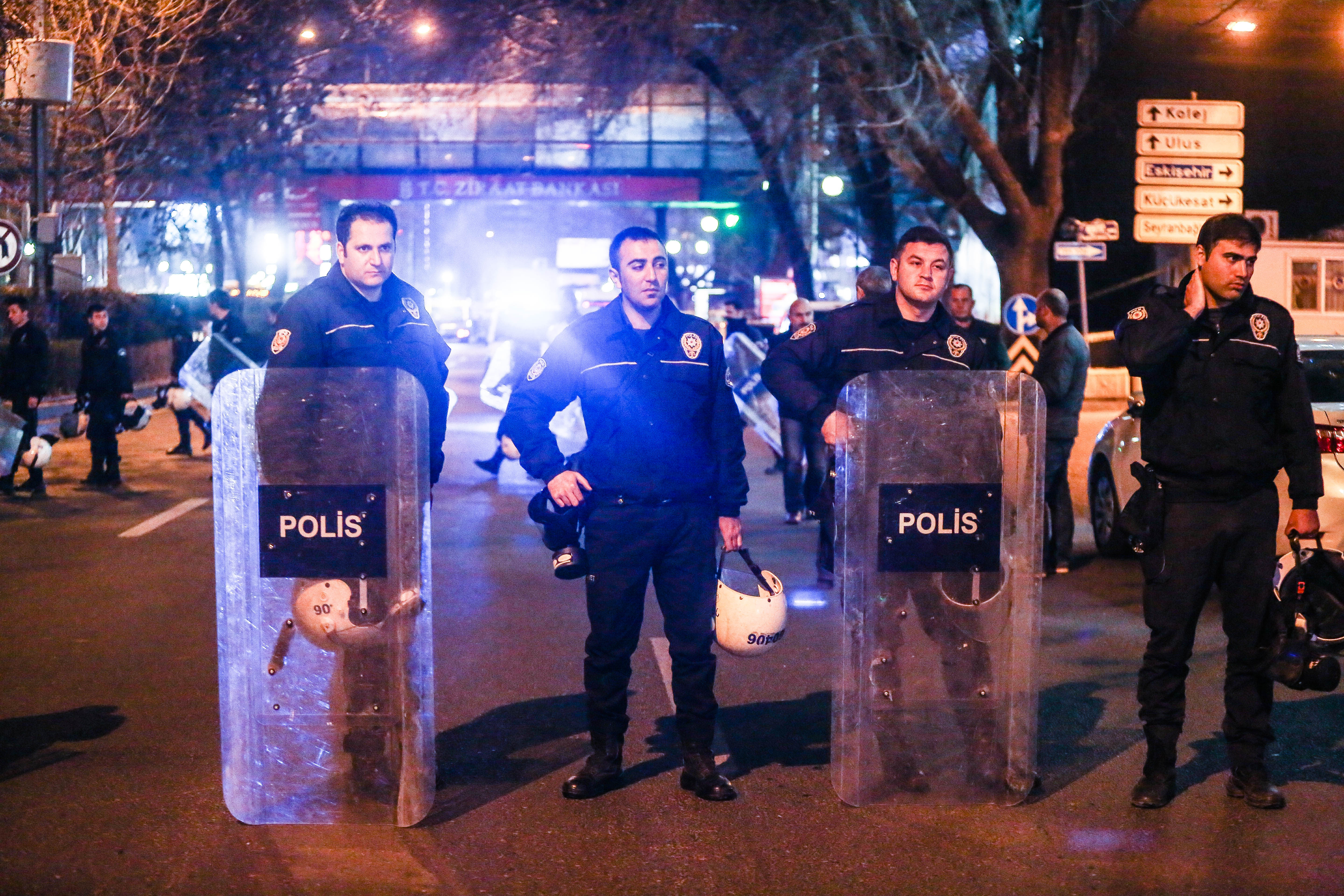 Turkish riot police secure the scene after an explosion in Ankara's central Kizilay district on March 13, 2016.