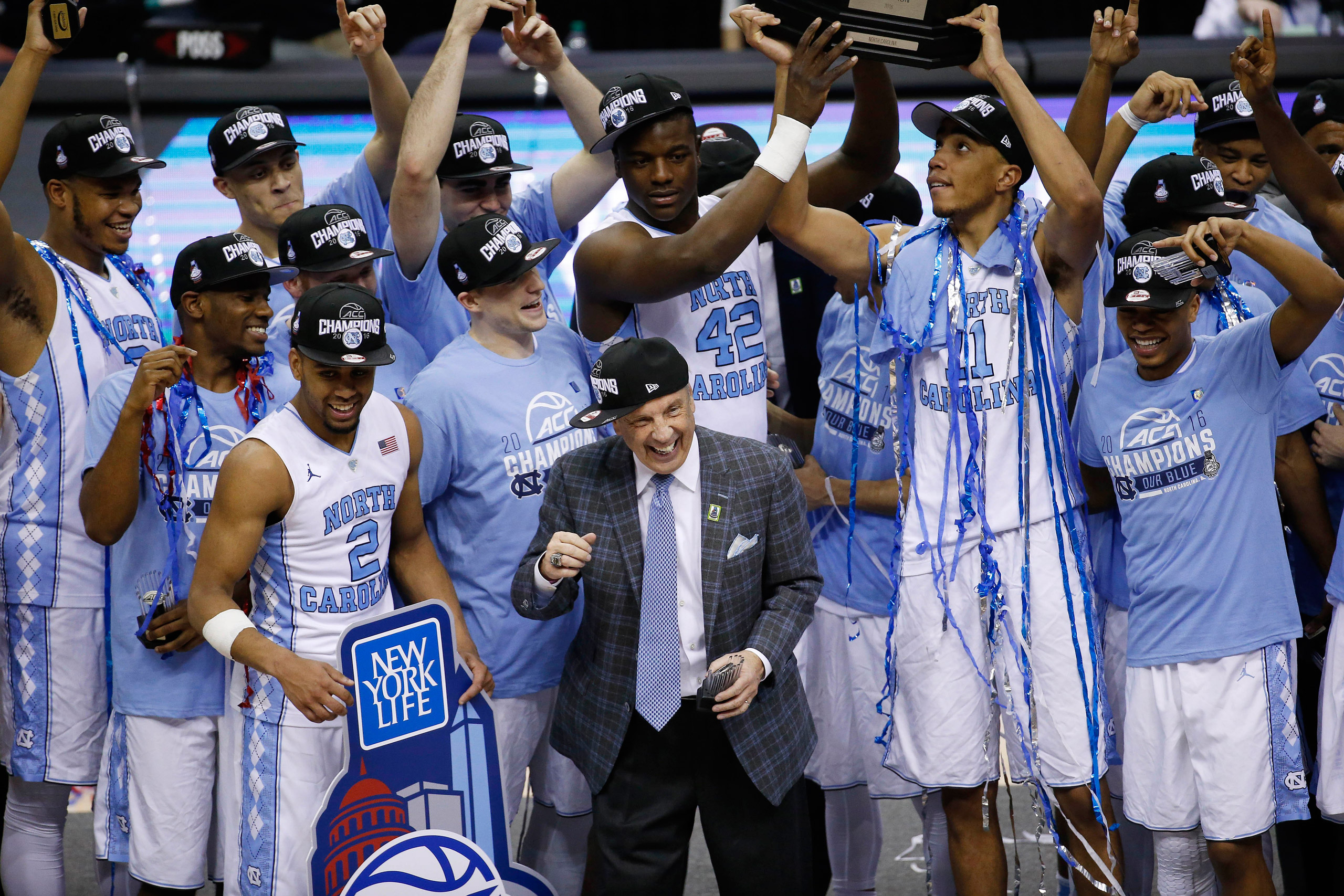 North Carolina head coach Roy Williams and players celebrate after an NCAA college basketball game in the championship of the Atlantic Coast Conference tournament against Virginia in Washington on  March 12, 2016.