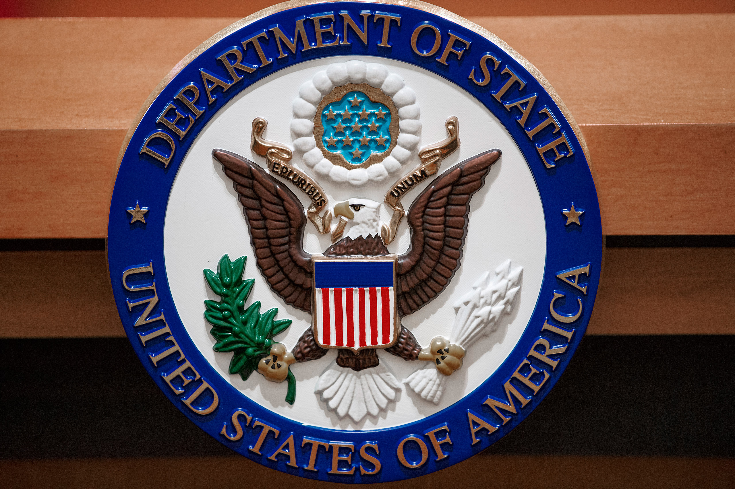 The seal of the U.S. Department of State is seen on the lectern in a briefing room in Washington, D.C., Nov. 26, 2013.