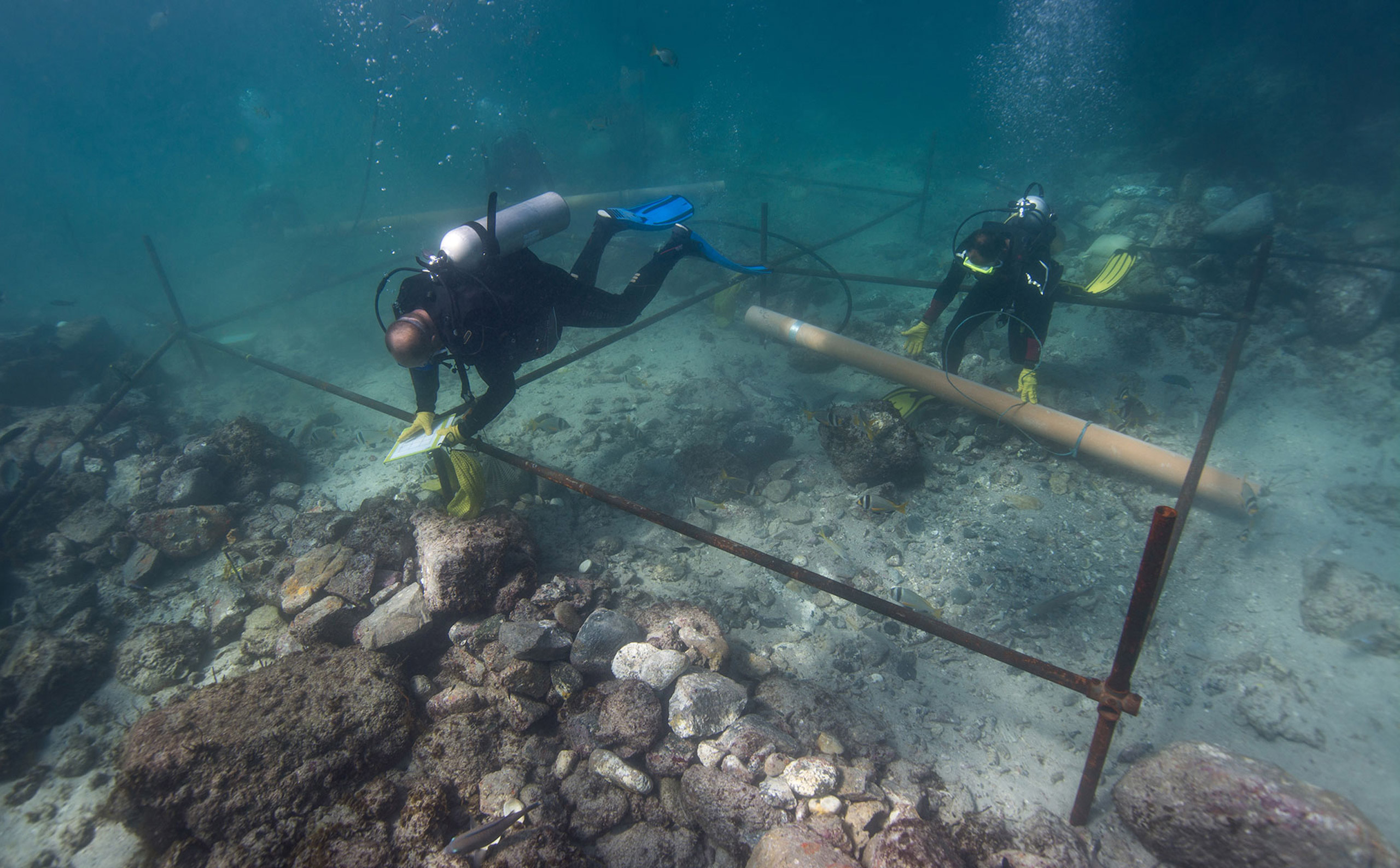 Divers excavate the wreck site of the Portuguese explorer Vasco da Gama's ship Esmeralda, which sank in a storm in May 1503 off the coast of Al Hallaniyah island in Oman, in this undated photo made available by Blue Water Recoveries on Mar. 15, 2016.