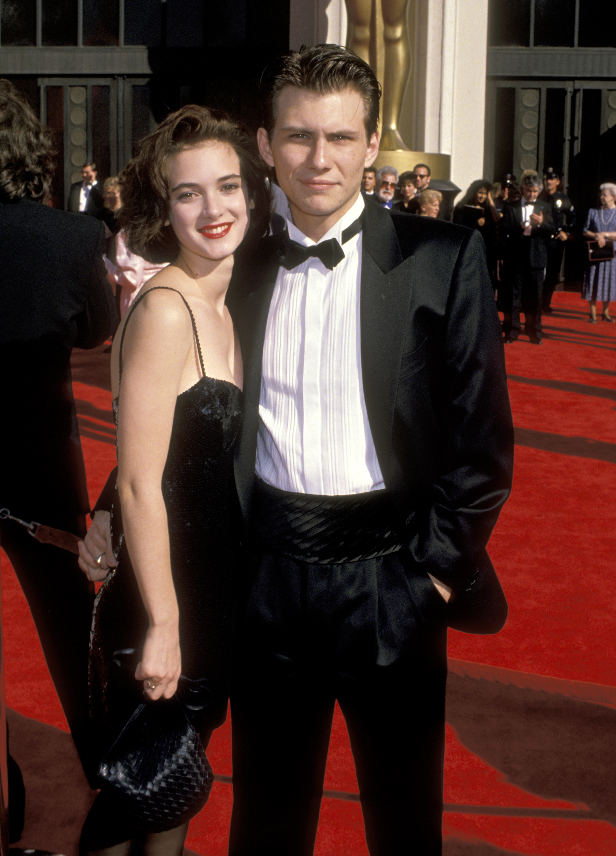 Winona Ryder and Christian Slater arrive at the 61st Academy Awards in Los Angeles, California on March 29, 1989.