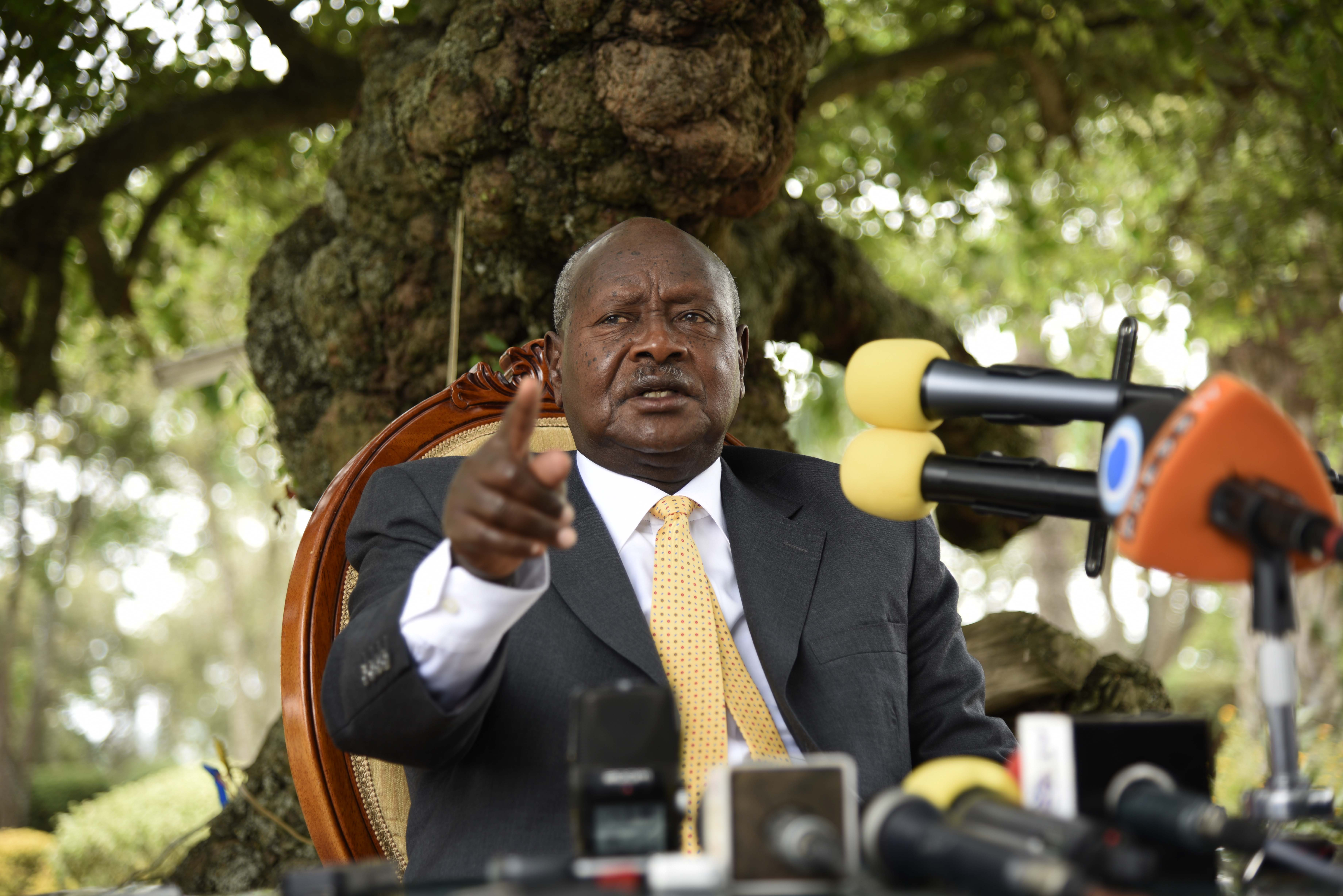 Newly re-elected president Yoweri Museveni, in power since three decades, gestures as he speaks during a press conference at his country house in Rwakitura on Feb. 21, 2016.