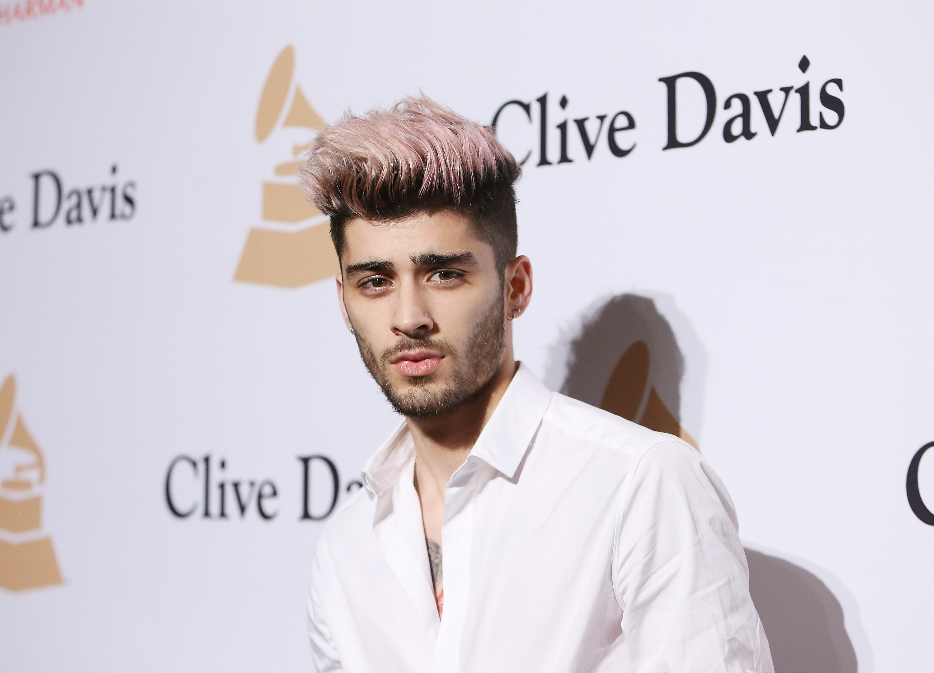 Zayn Malik arrives at the 2016 Pre-GRAMMY Gala and Salute to Industry Icons at The Beverly Hilton Hotel on February 14, 2016 in Beverly Hills, California.