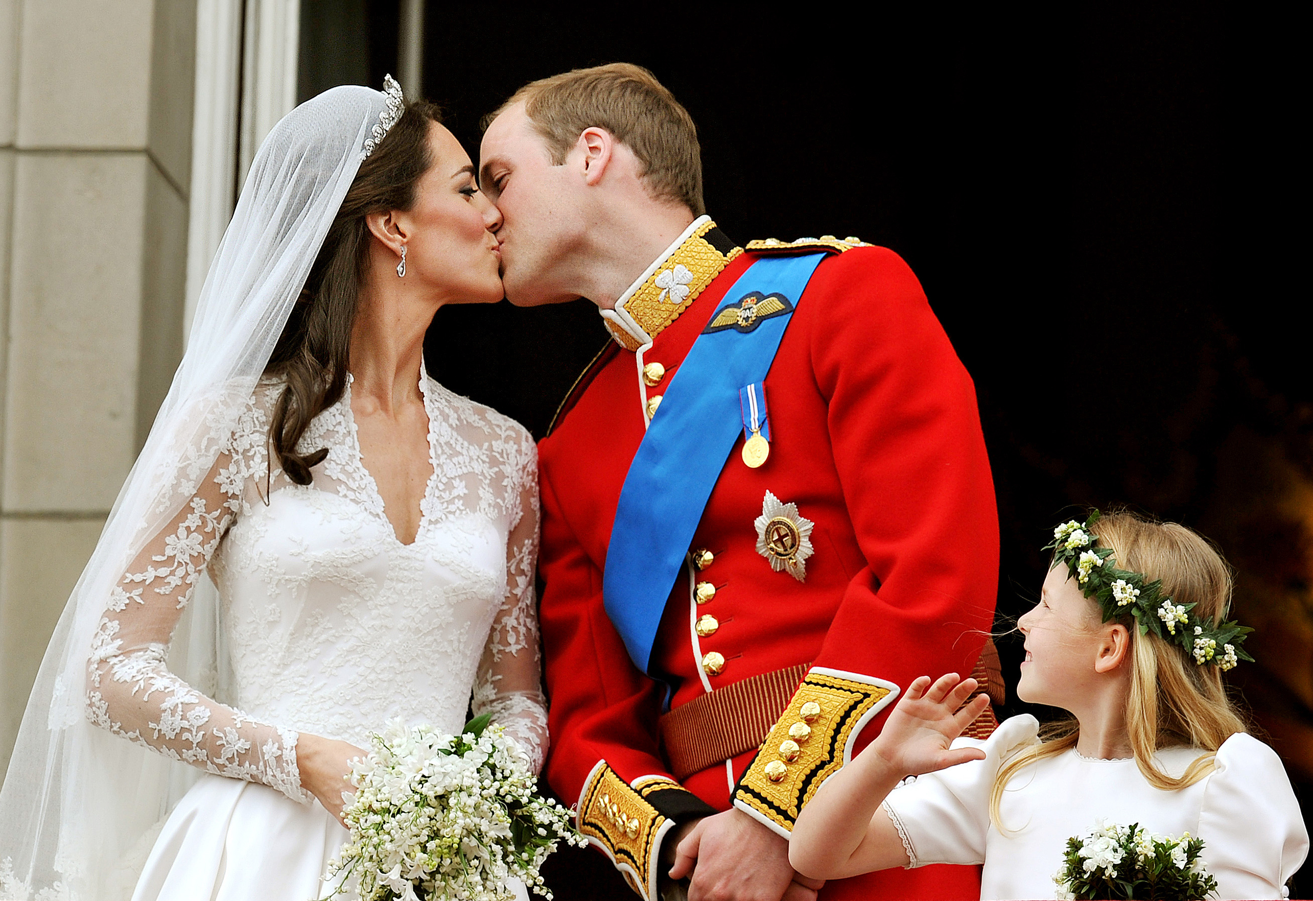 Prince William and Catherine kiss on the balcony of Buckingham Palace after getting married in London on April 29, 2011.
