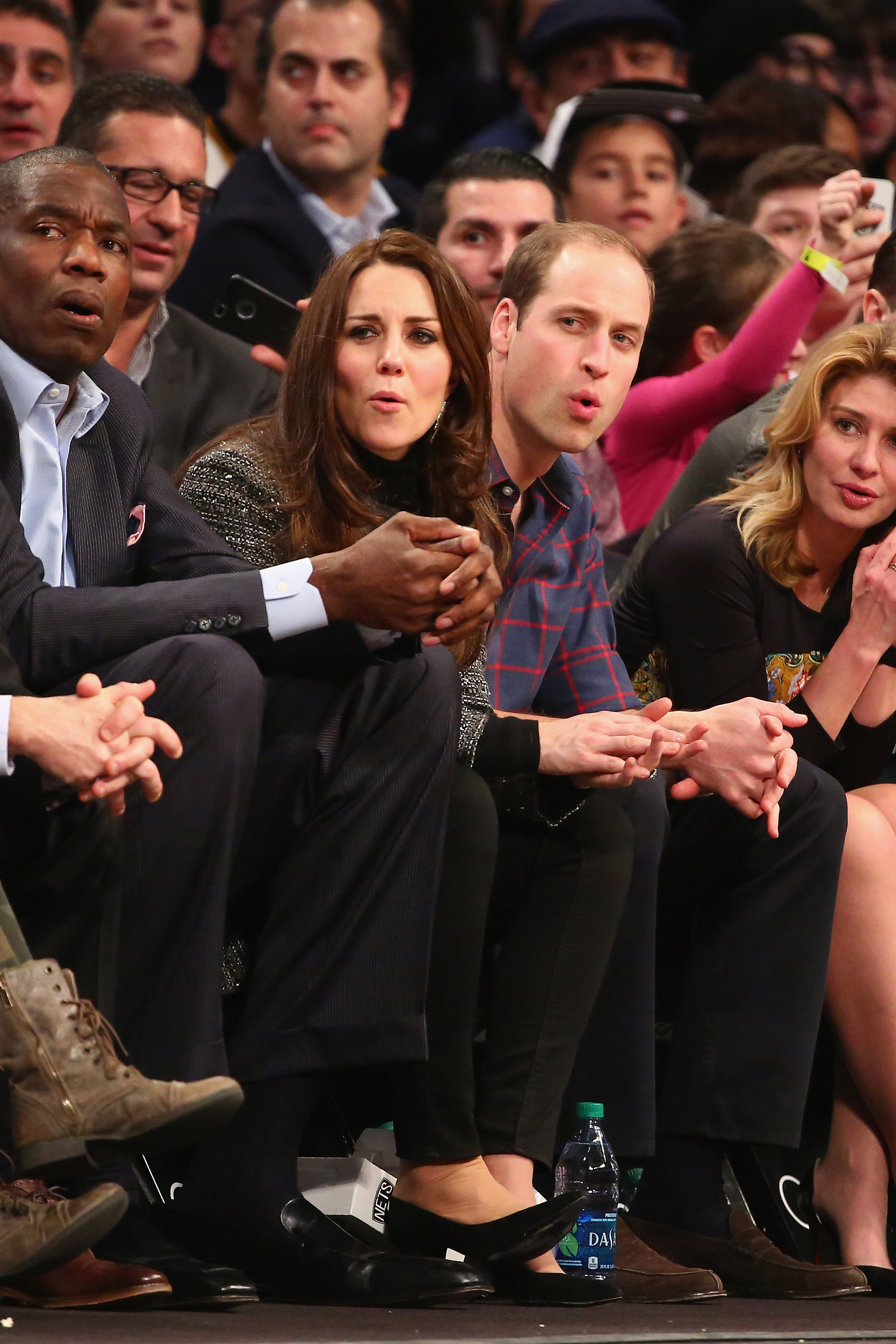Prince William, Duke of Cambridge and Catherine, Duchess of Cambridge, watch the game between the Cleveland Cavaliers and the Brooklyn Nets at Barclays Center in New York City on Dec. 8, 2014.