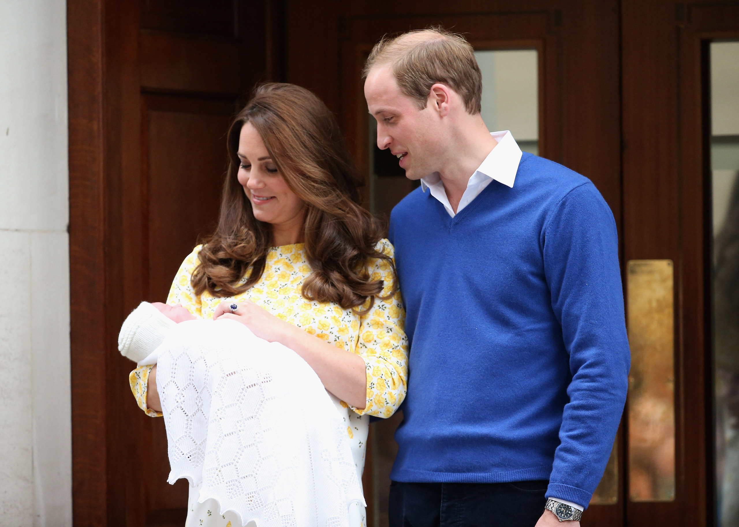Prince William, Duke of Cambridge and Catherine, Duchess Of Cambridge depart the Lindo Wing with their new baby daughter, Princess Charlotte, at St Mary's Hospital in London on May 2, 2015.