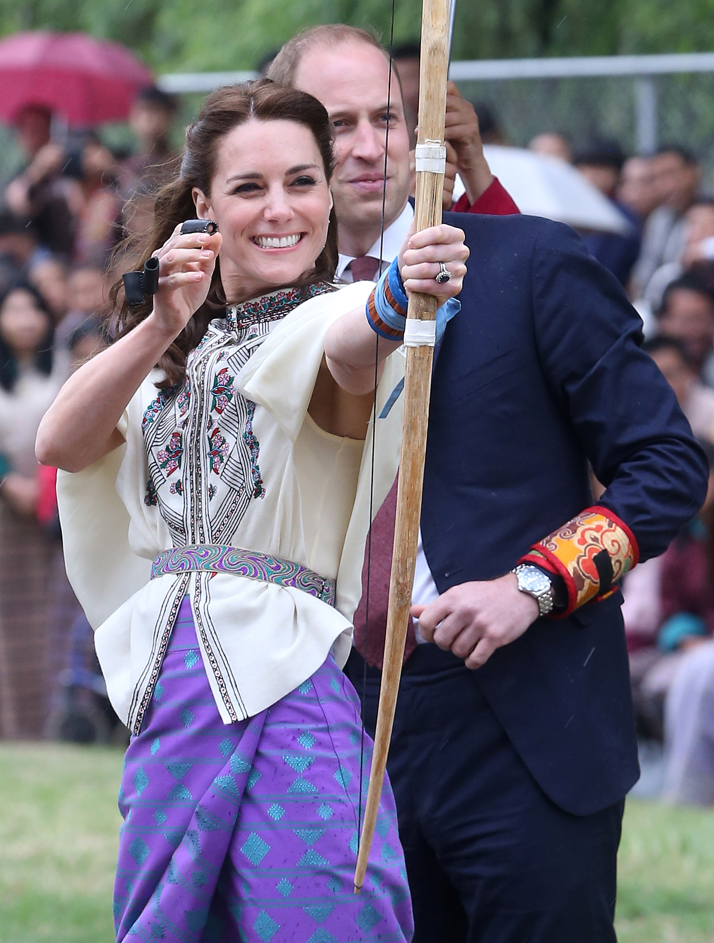 Catherine, Duchess of Cambridge and Prince William, Duke of Cambridge laugh while taking part in archery, Bhutan's national sport,  in Thimphu, Bhutan on April 14, 2016.