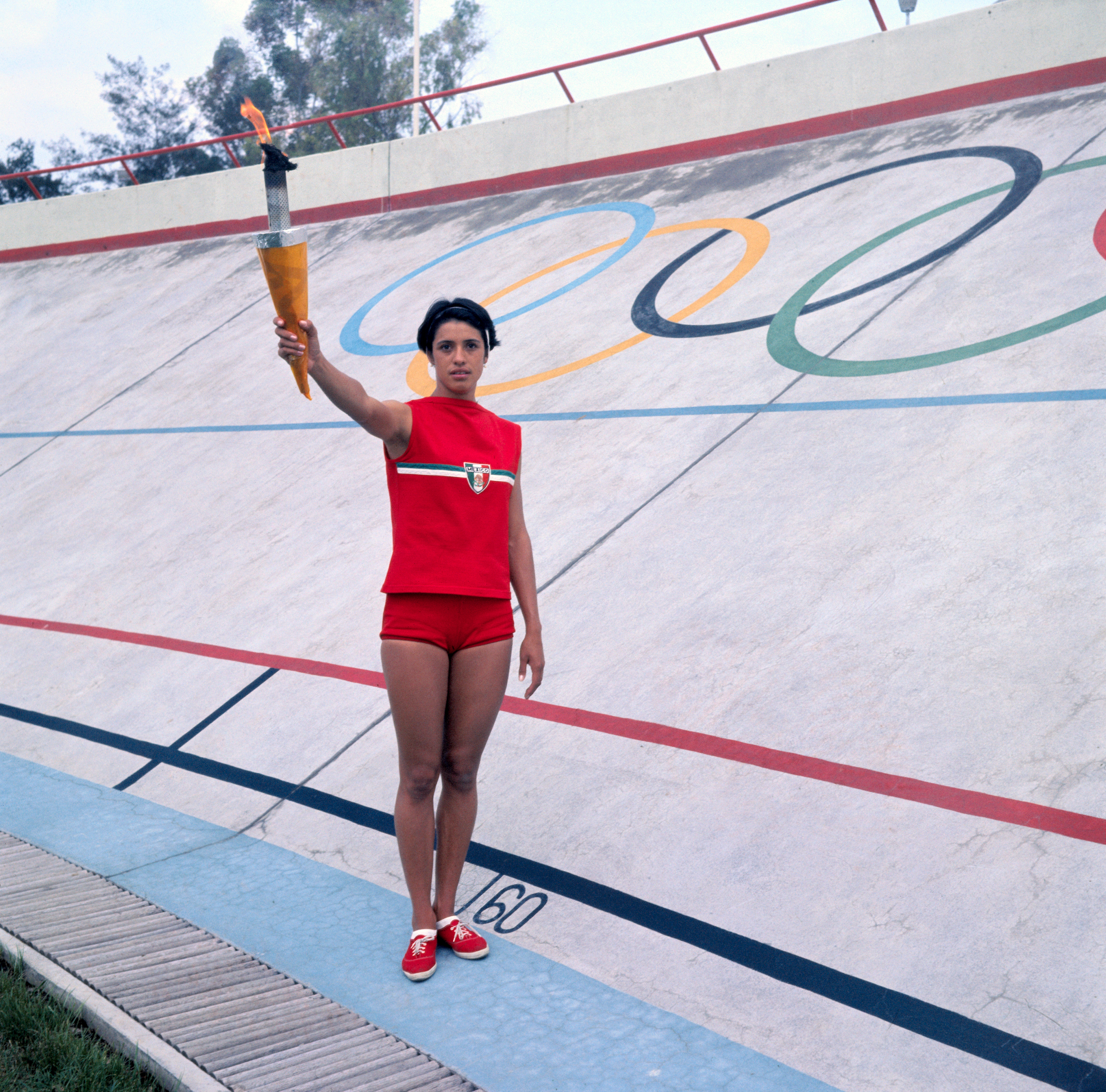 Enriqueta Basilio, 20, will be the first woman in history to carry the Olympic torch on its last leg and ignite the Olympic flame for the 1968 October game in Mexico City. Enriqueta, Mexico's 80-meter hurdle record-holder is shown here rehearsing on July 22, 1968 in Mexico City, Mexico