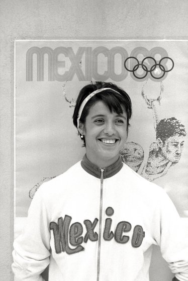 Enriqueta Basilio, a participating athlete at the Olympic Games, is the first woman to light the Olympic Flame. Mexico City, 1968.