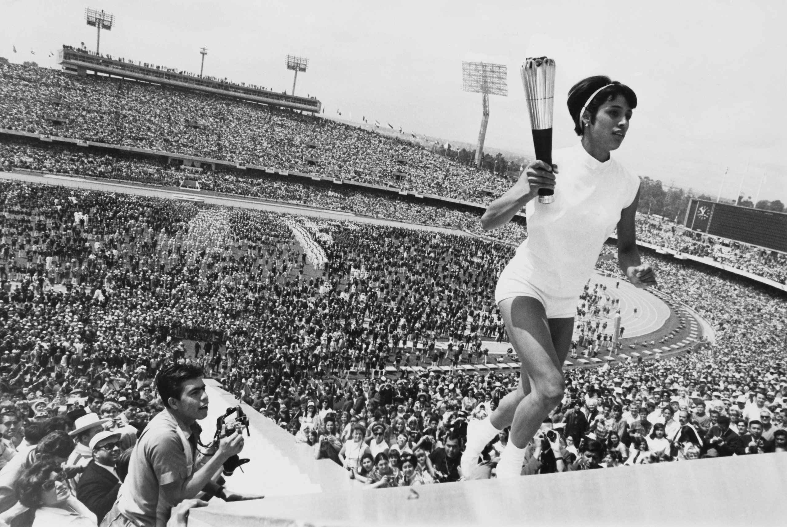 Mexican hurdler Enriqueta Basilio carries the Olympic torch to the cauldron during the opening ceremony of the 1968 Summer Olympics in Mexico City, Mexico, Oct. 12, 1968. The flame was lit in Olympia, Greece, and retraced the voyage of Columbus to the New World.