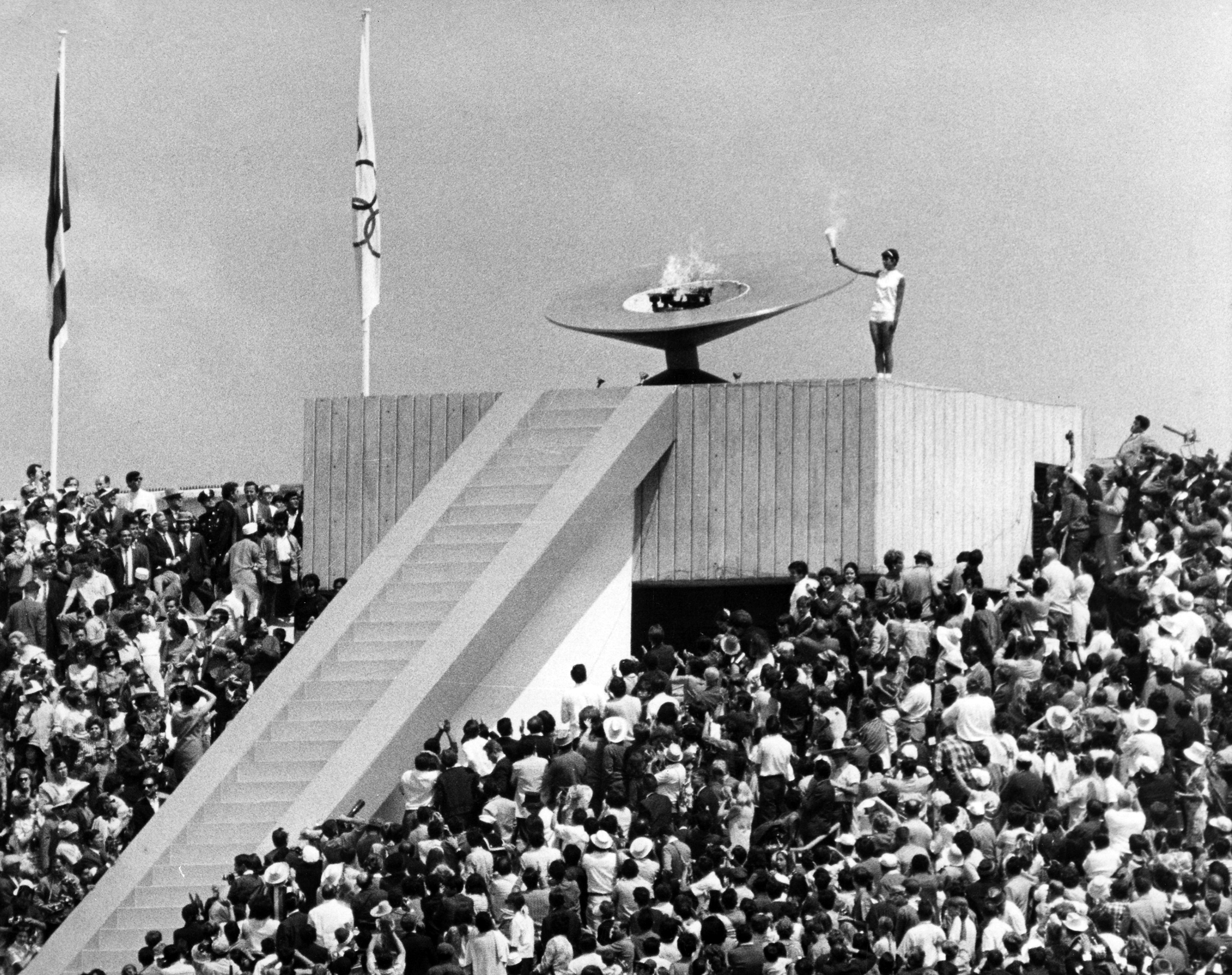 Mexican athlete Norma Enriqueta Basilio last carrier of the Olympic torch is pictured a moment after lighting the Olympic Cauldron, during the opening of the 19th Olympic games in Mexico City, Mexico, Oct. 12, 1968.