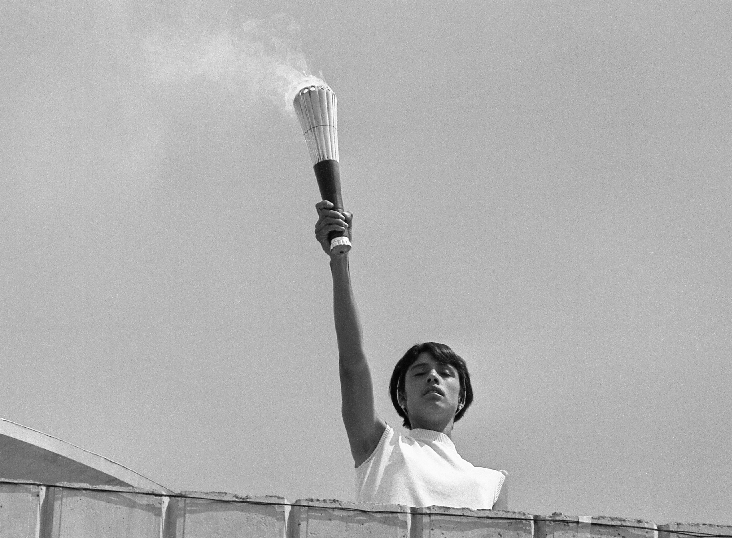 Mexican athlete Norma Enriqueta Basilio, last carrier of the Olympic torch, is pictured a moment before lighting the Olympic Cauldron, during the opening of the 19th Olympic games in Mexico City, Mexico, Oct. 12, 1968.