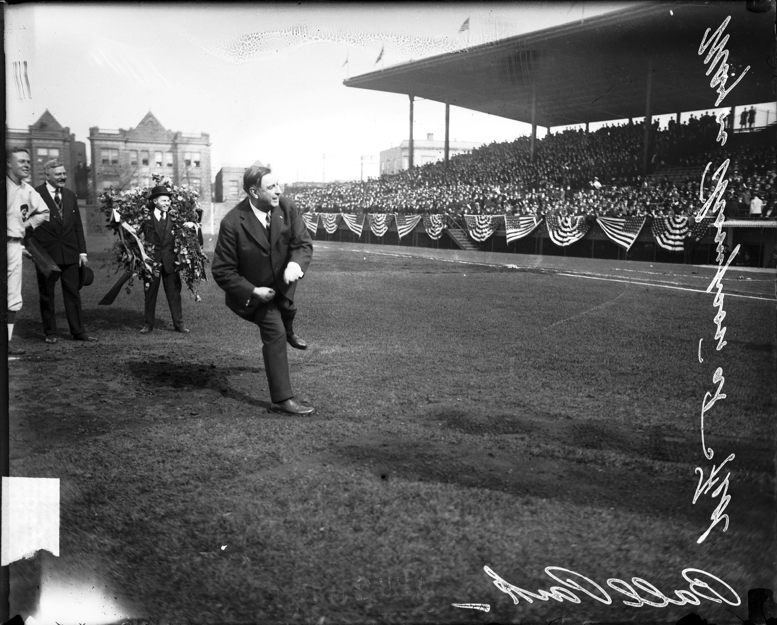 Chicago Mayor William Hale Thompson throwing first pitch at a Chicago Whales baseball game at Weeghman Park, Chicago, 1915.