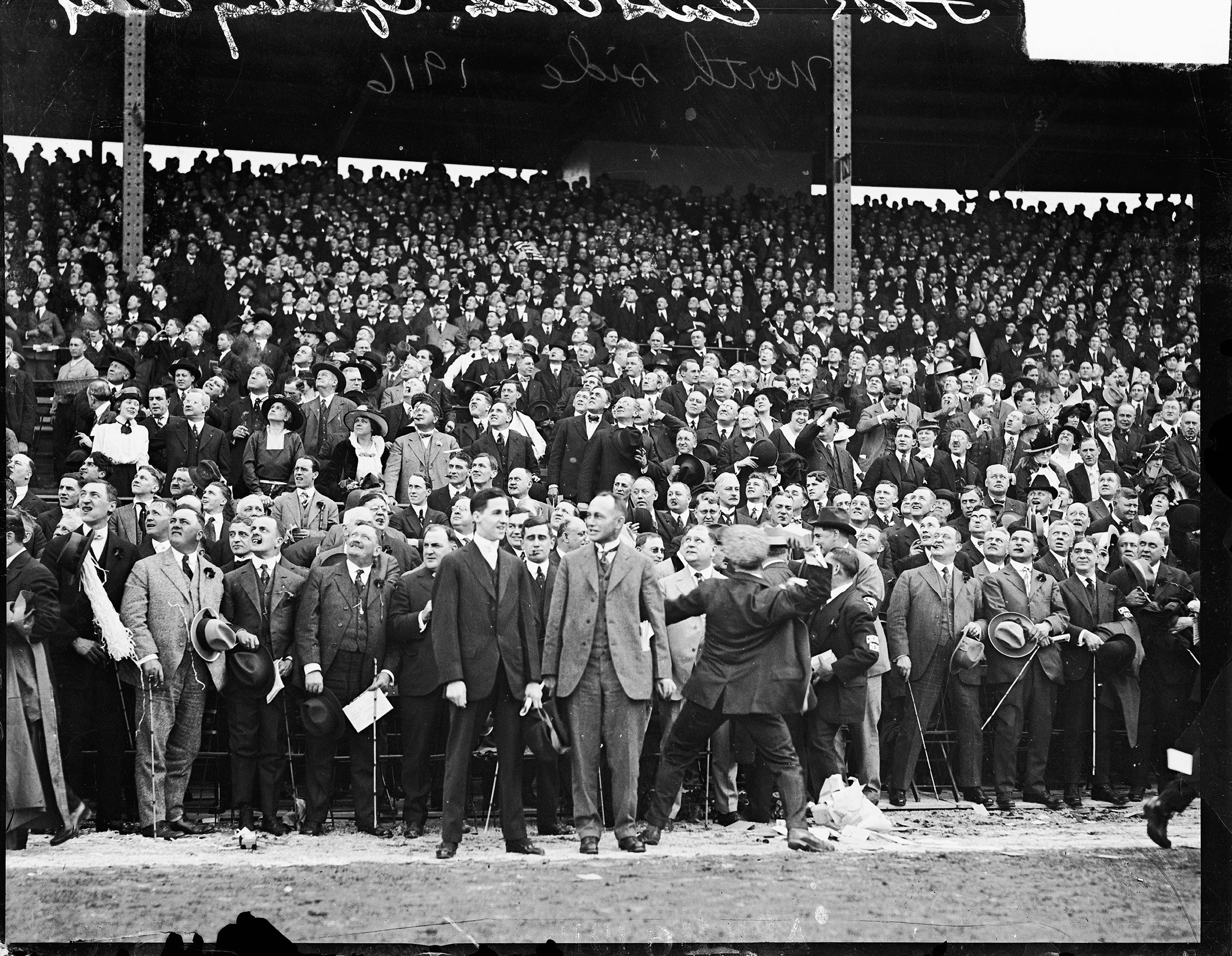 National League's Chicago Cubs baseball game spectators standing in the grandstands on opening day at Weeghman Park, Chicago, 1916.
