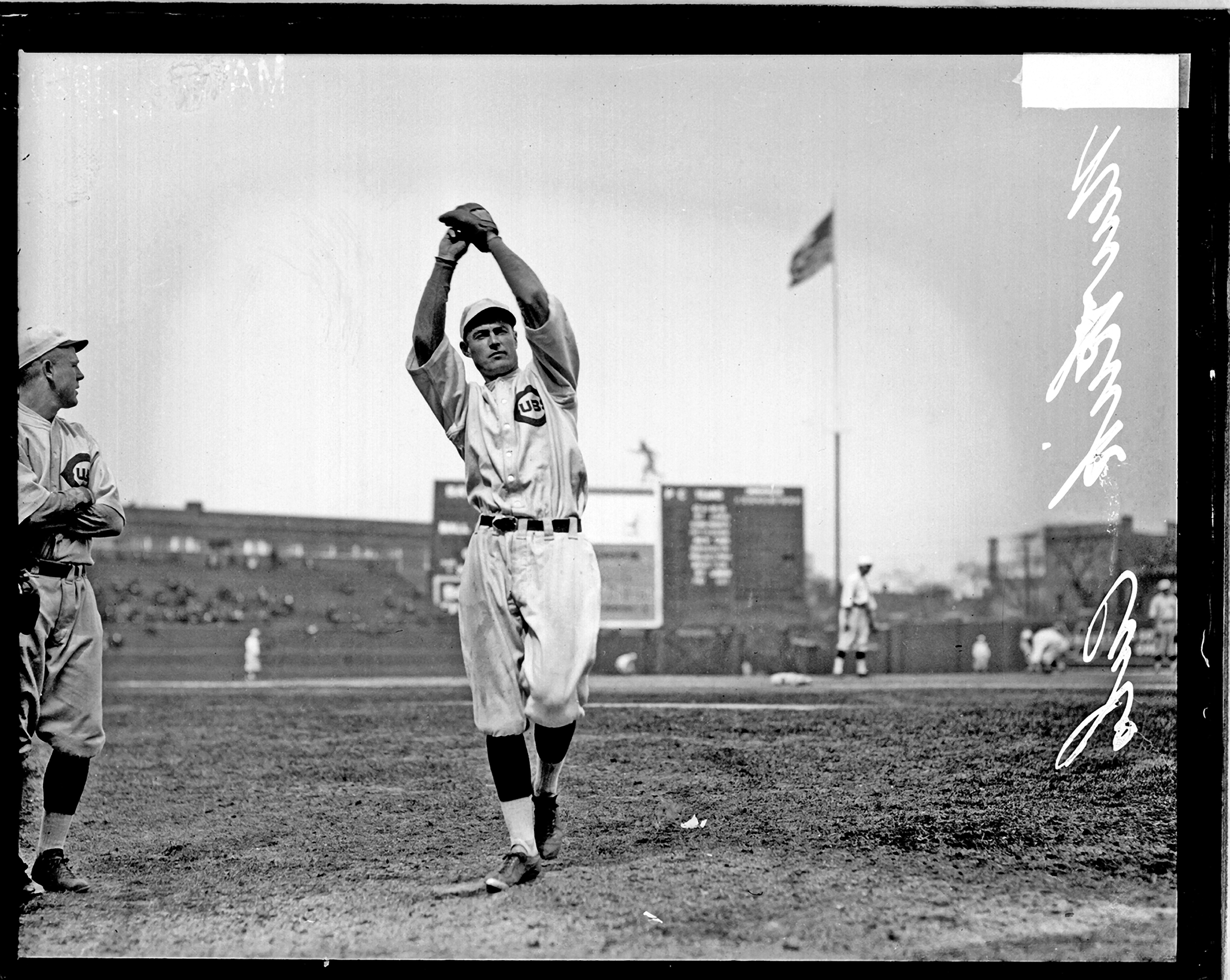 Chicago Cubs baseball player Newkirk winding up to throw a baseball at Weeghman Park, Chicago, 1920.