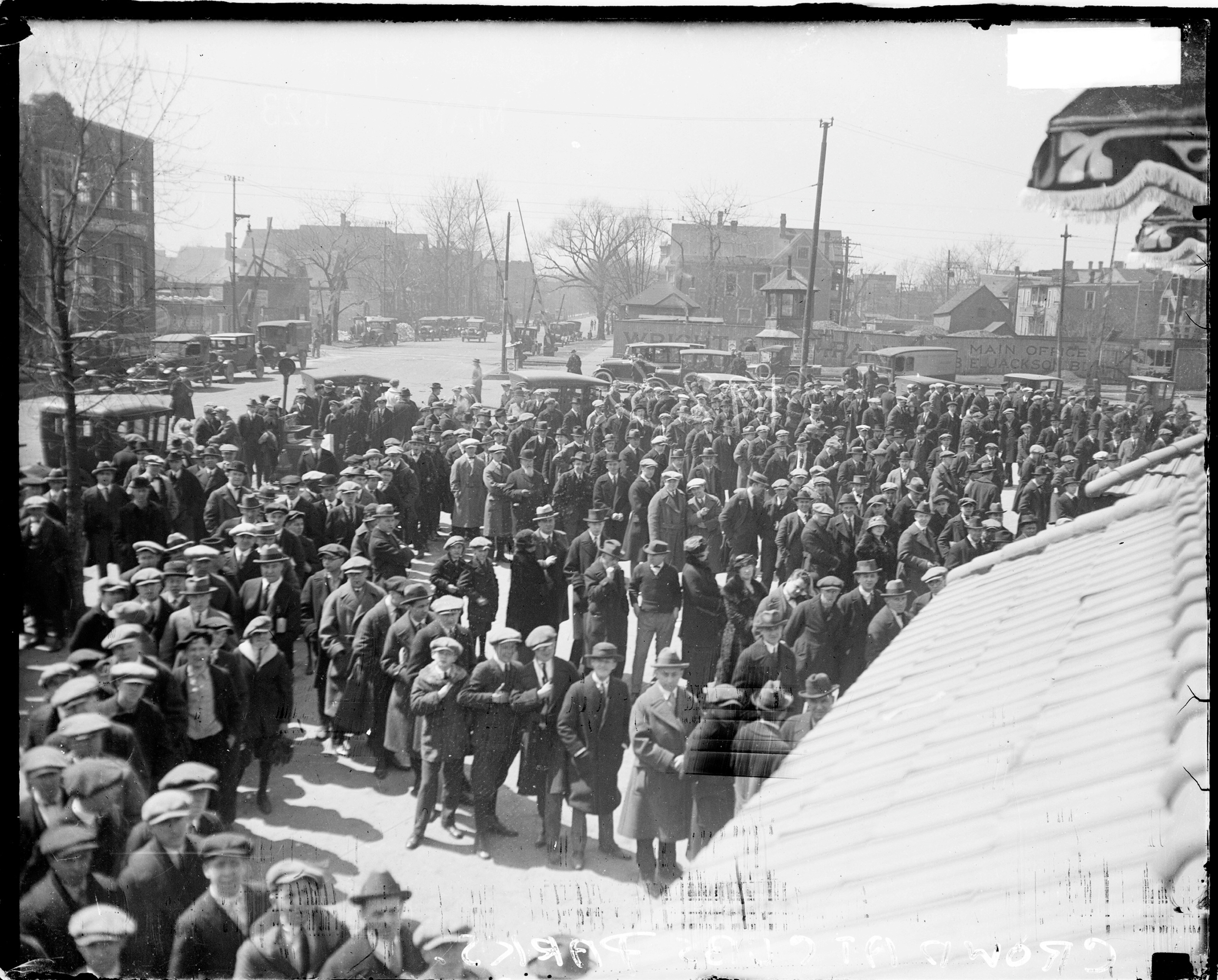 Crowds waiting in lines outside Weeghman Park, Chicago, 1923. From the Chicago Daily News collection.