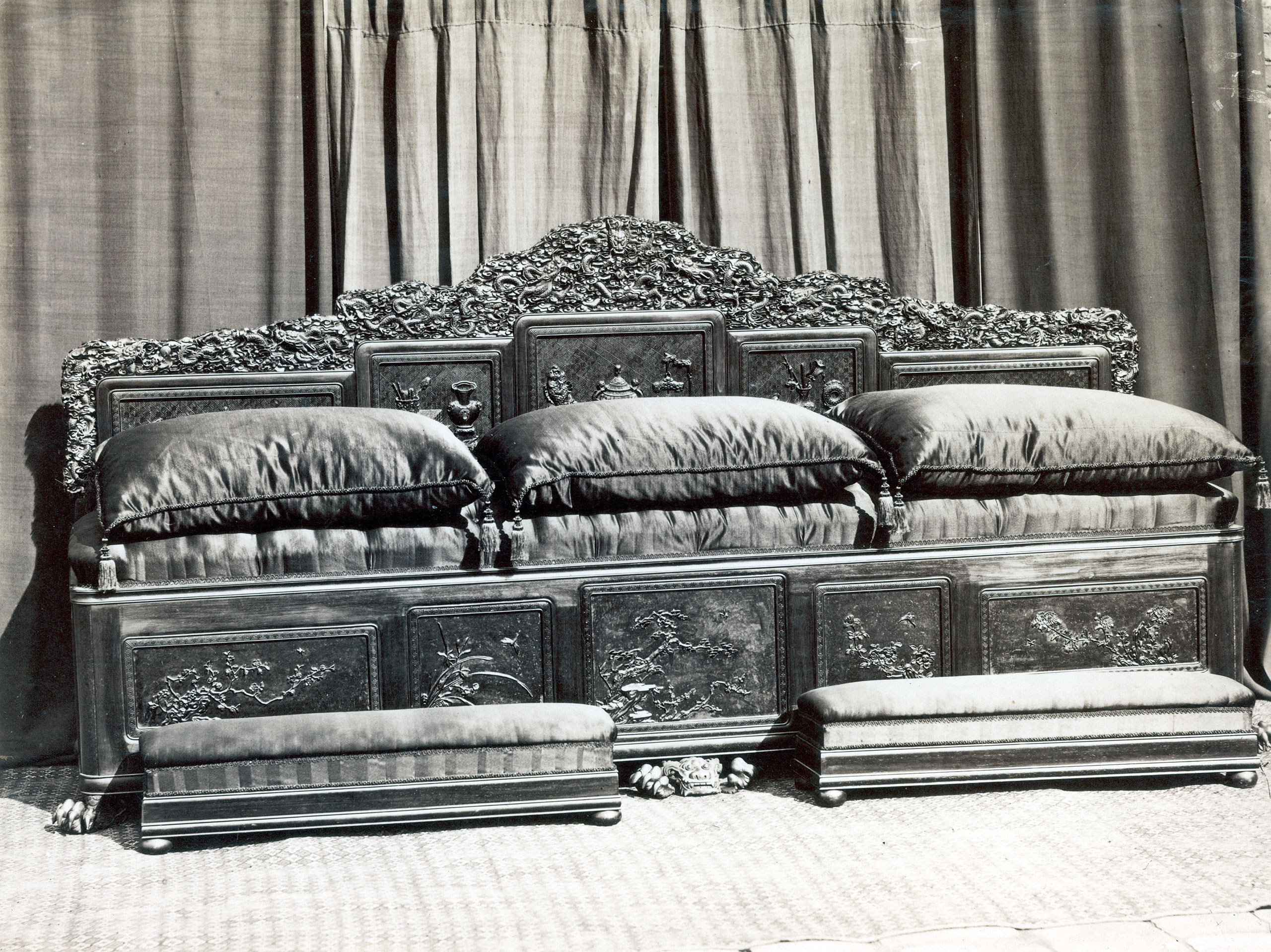 An ornately carved throne and matching footstools from the Summer Palace, Peking, Bejing, 1870.