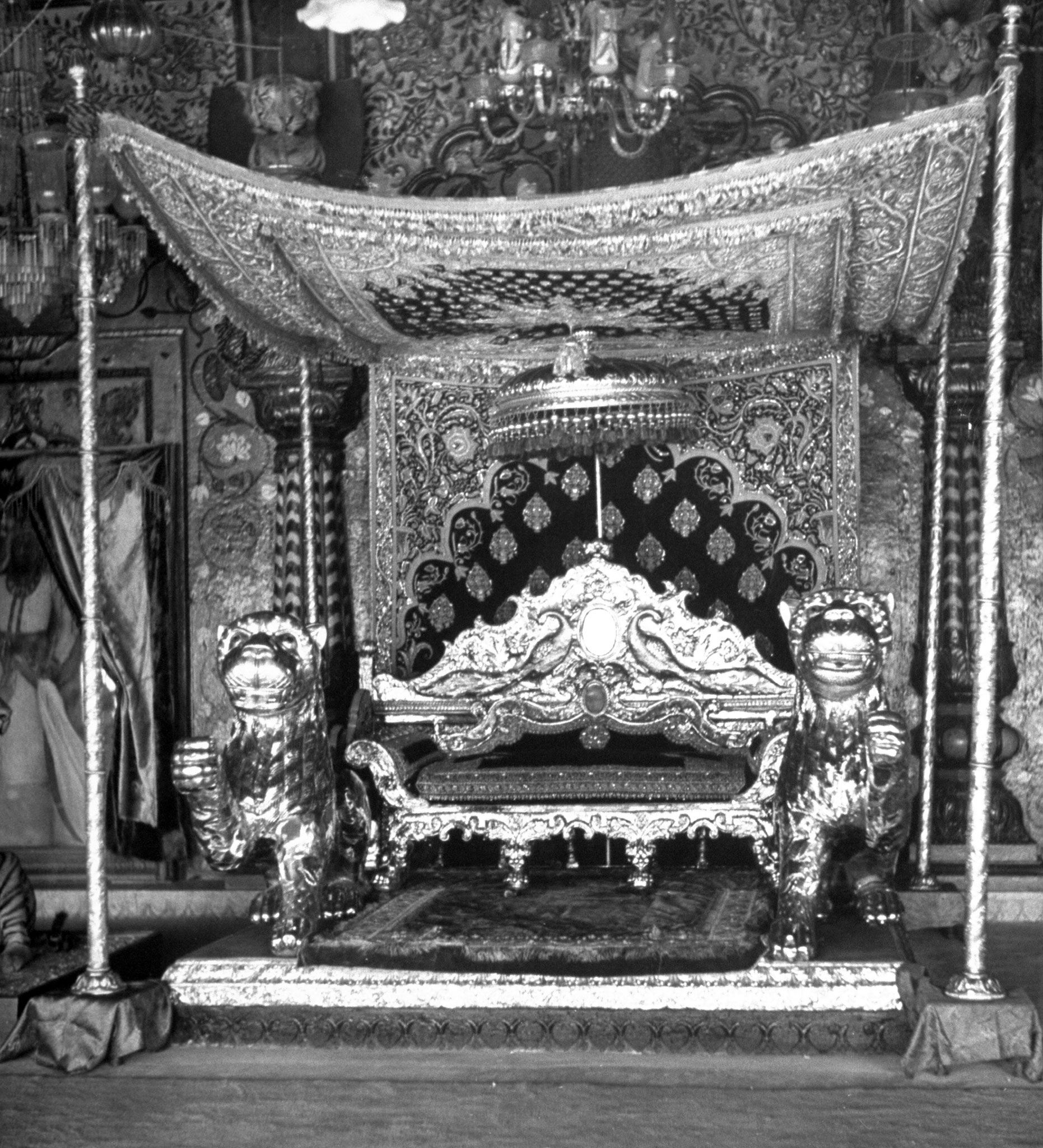 Marahaja's throne room in the main palace made of beautiful decorations. India, 1951.