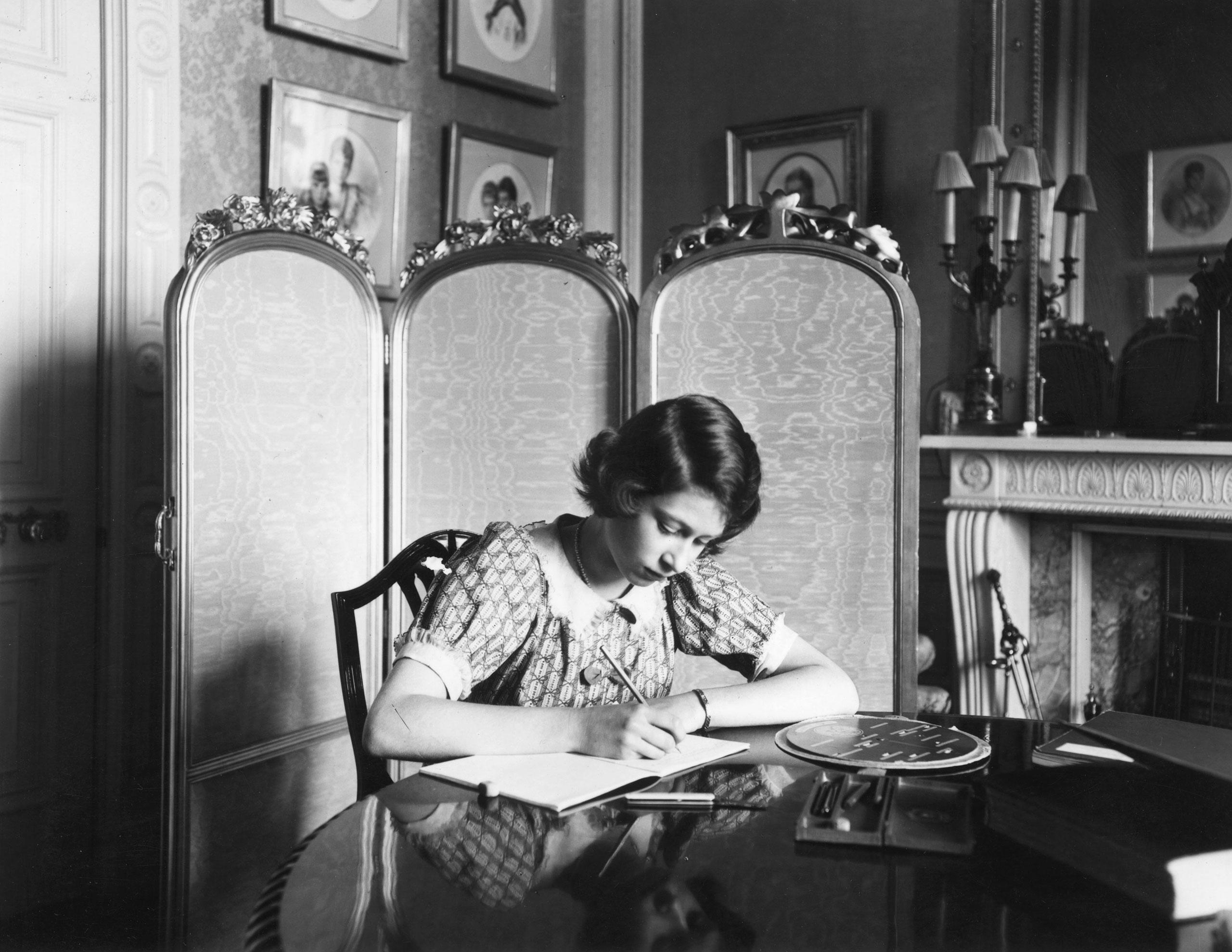 Princess Elizabeth working on her studies at a desk in Windsor Castle. June 1940.