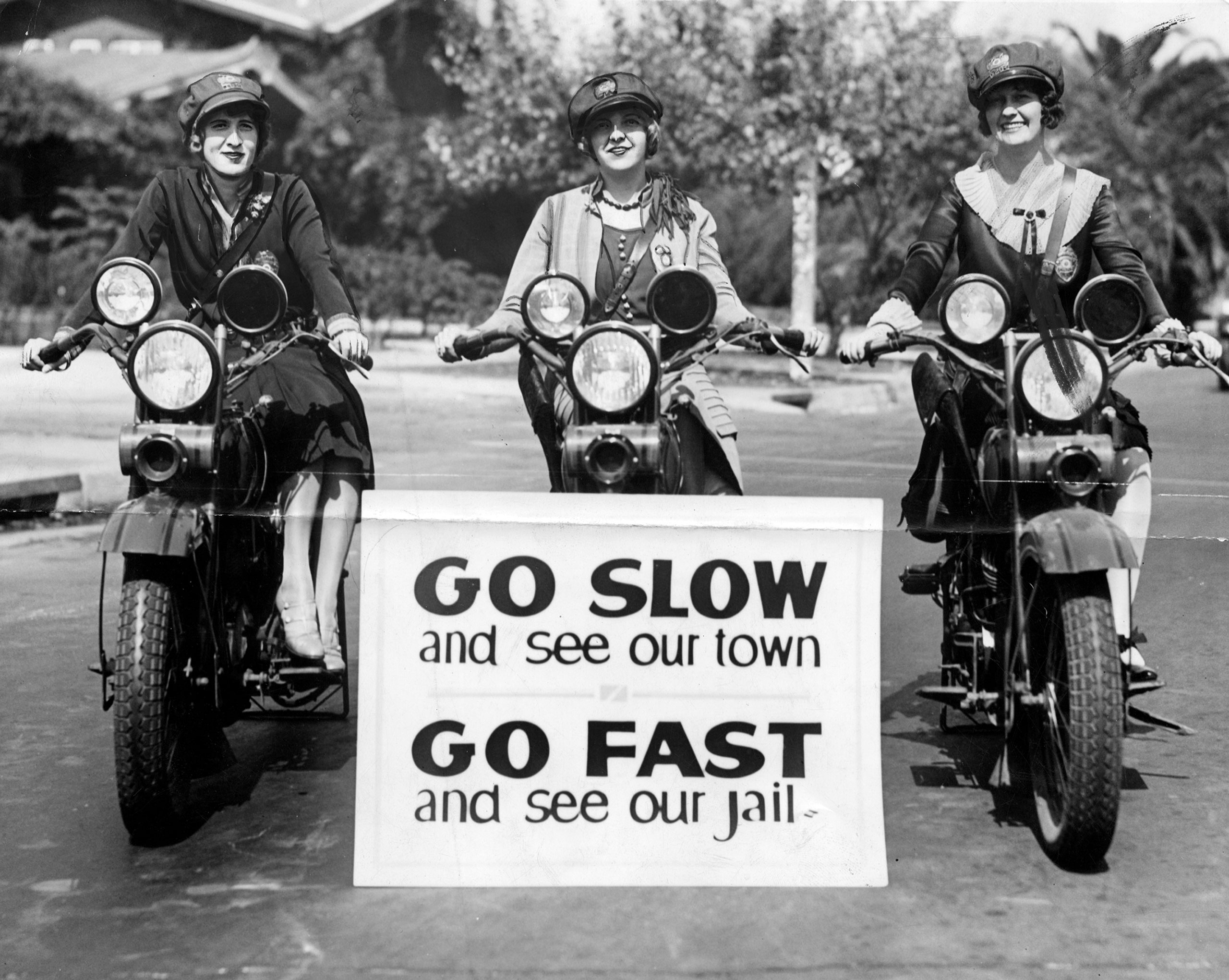 Three motorcycle officers with the LAPD are on duty in 1927. From left to right: Miss Hildur Fleming; Miss Myra Richardson,; and Miss Beryl Wilson.