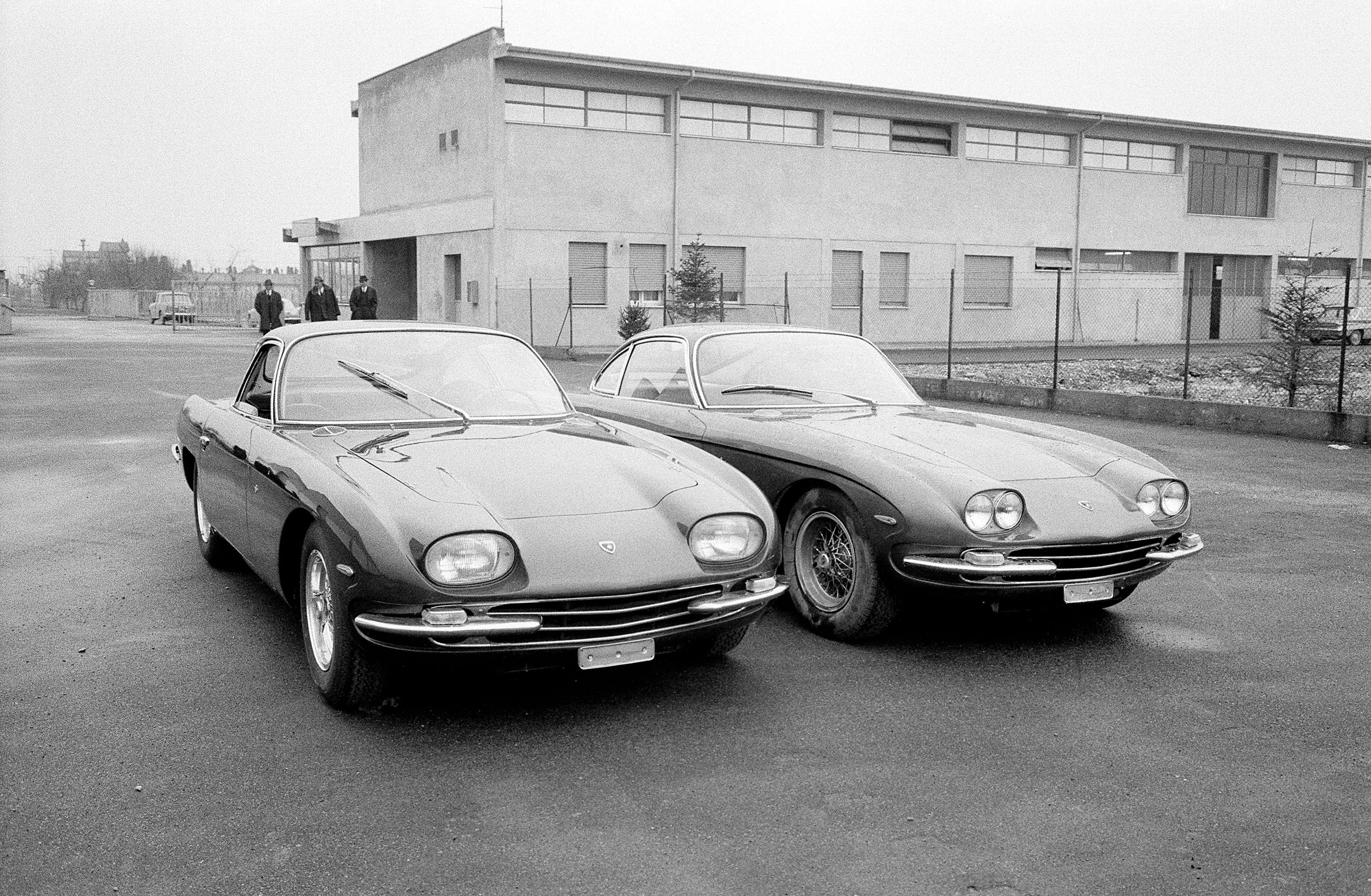 Lamborghini 400GT 2+2, with four separate headlamps, is introduced to the Press alongside the prior 350GT model, which had followed the 350GTV. 1966.