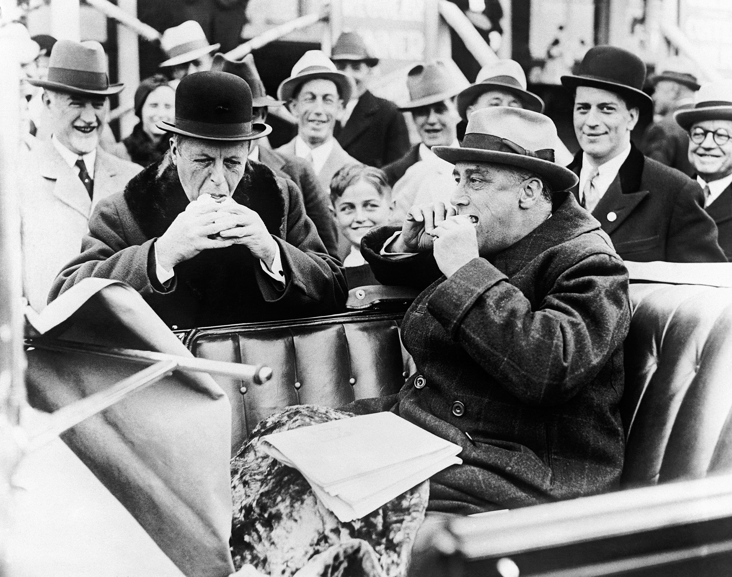 Gov. Joseph Ely of Massachusetts, left, candidate for re-election, and Gov. Franklin D. Roosevelt of New York, stop for a hot dog on the Mohawk Trail in Massachusetts, Oct. 30, 1932, where they are campaigning together.