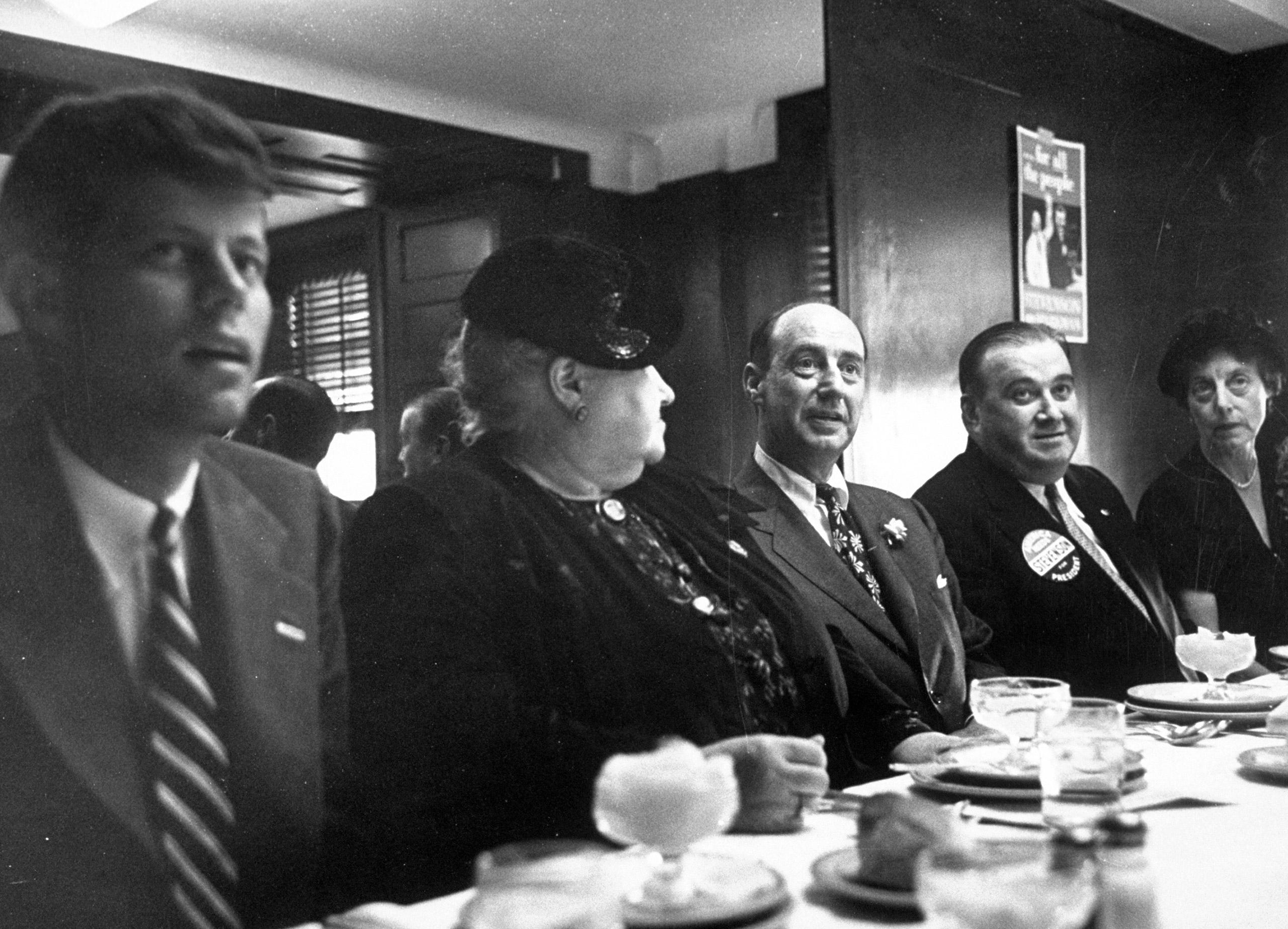 Adlai E. Stevenson (3L),  Massachusetts Governor Paul Denver (4L) and John F. Kennedy (L) during their campaign trail, eating, 1952.