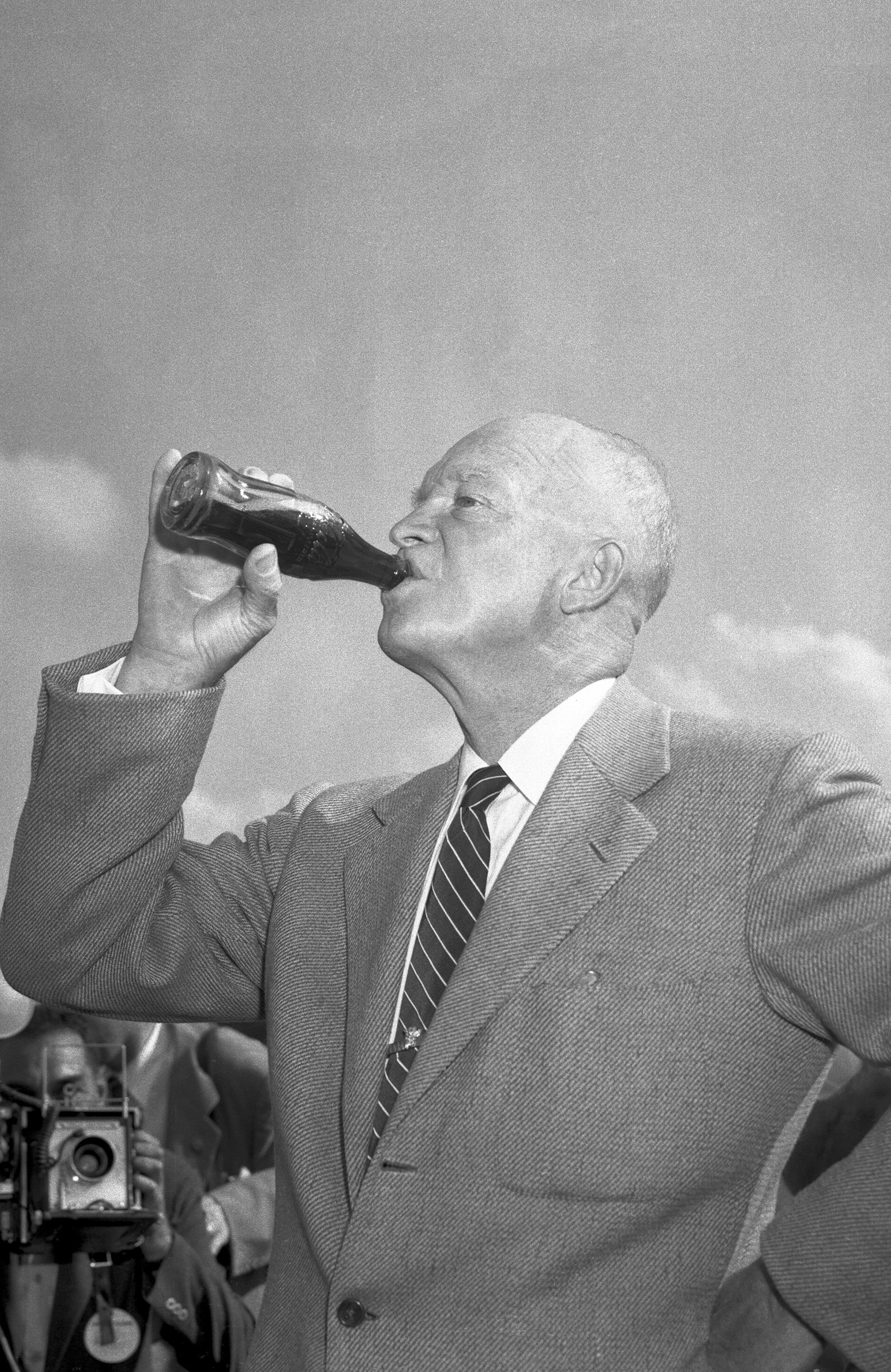 President Eisenhower drinks soda from a bottle during the big Republican rally at his Gettysburg farm, which was the kickoff of his campaign for re-election. Sept. 13, 1956.
