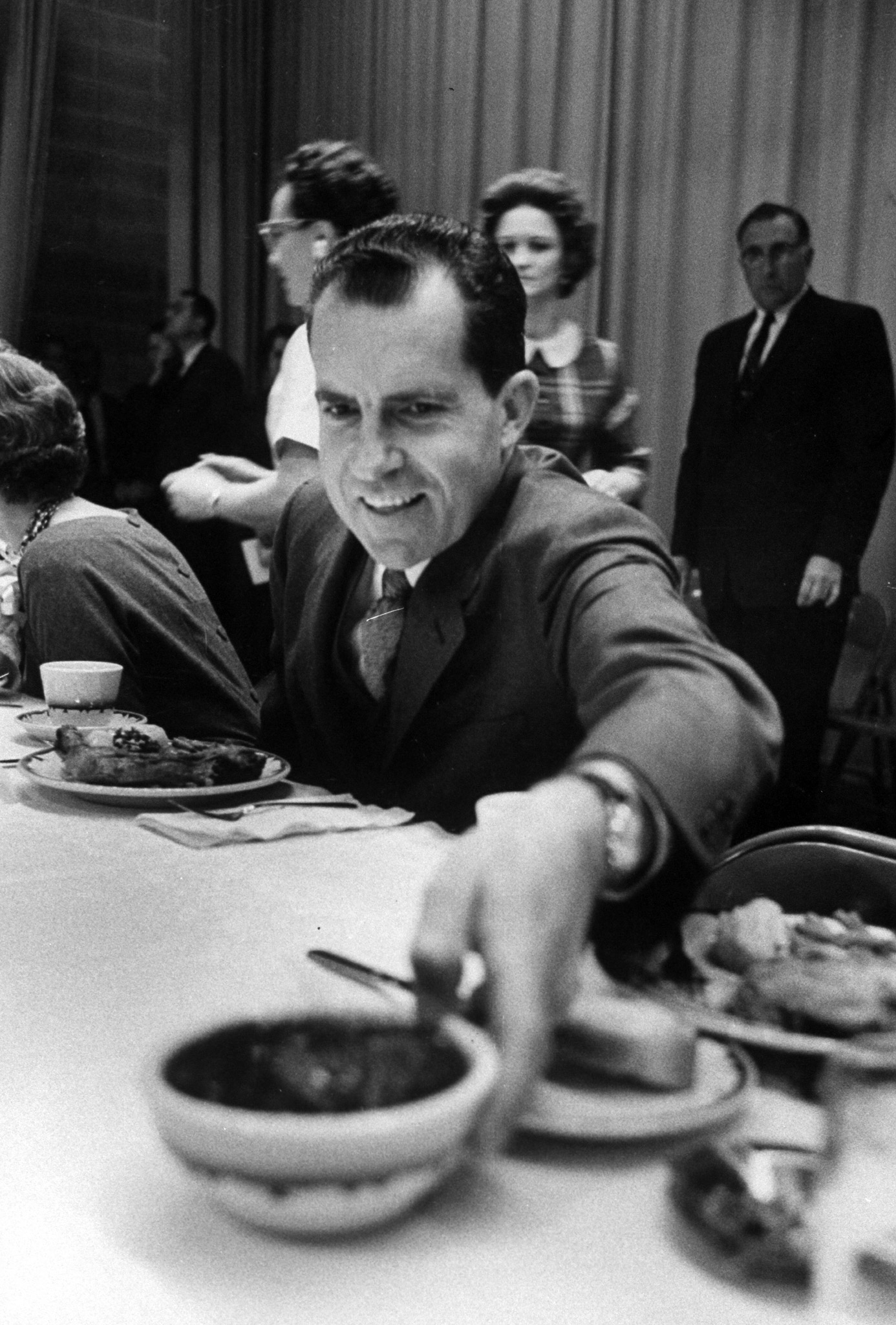 Richard M. Nixon eating cranberries with his meal during campaign. 1959.