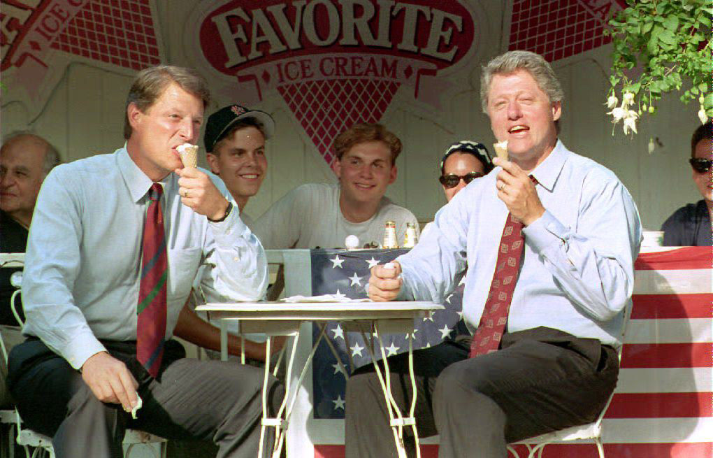 Democratic presidential candidate Bill Clinton eats an ice cream cone with running mate Al Gore at the My Favorite shop in Buffalo, New York. The candidates are on the last day of their third bus tour. Aug. 23, 1992.
