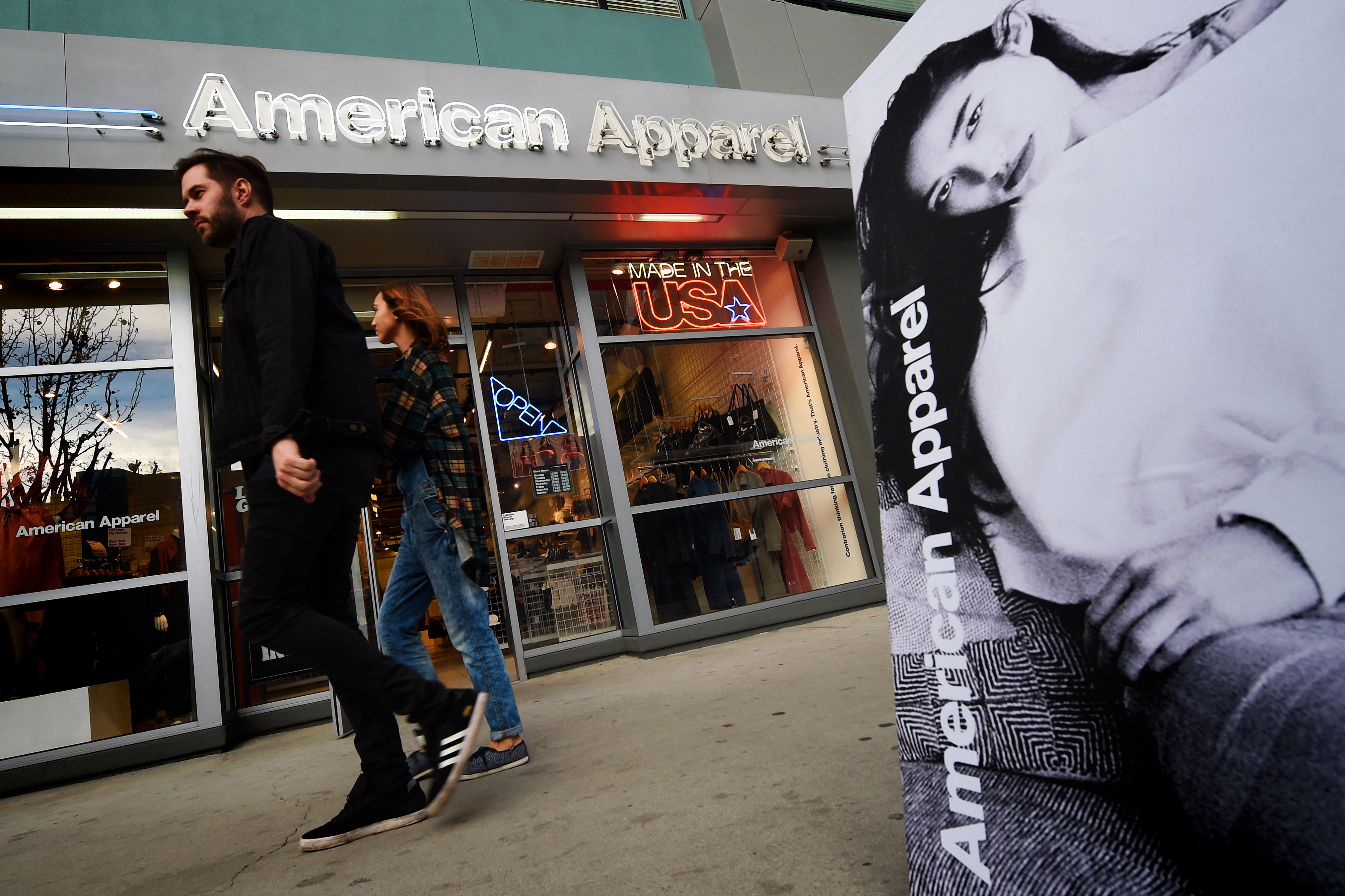 People walk past an American Apparel store in downtown Los Angeles on Jan. 27, 2016.